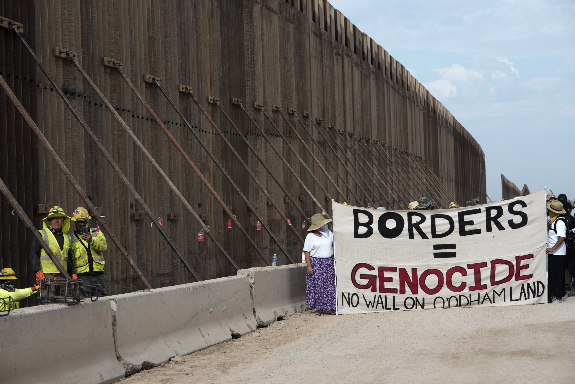 Protesters say they will hold President-elect Joe Biden to account on his promise to stop the Trump administration's border wall construction.