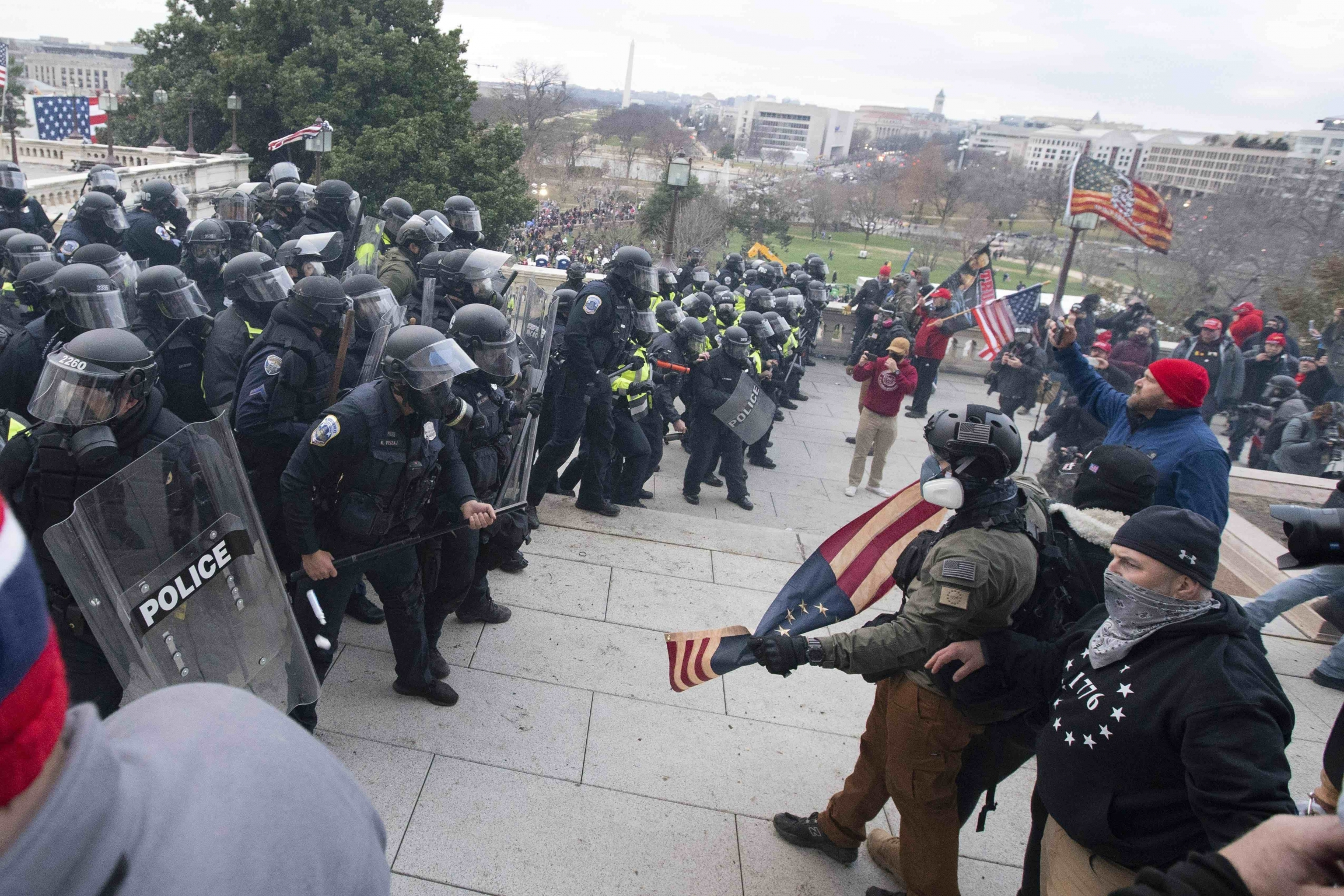 USCapitol Police push back rioters who were trying to enter the USCapitol on Wednesday, Jan. 6, 2021, in Washington, DC.