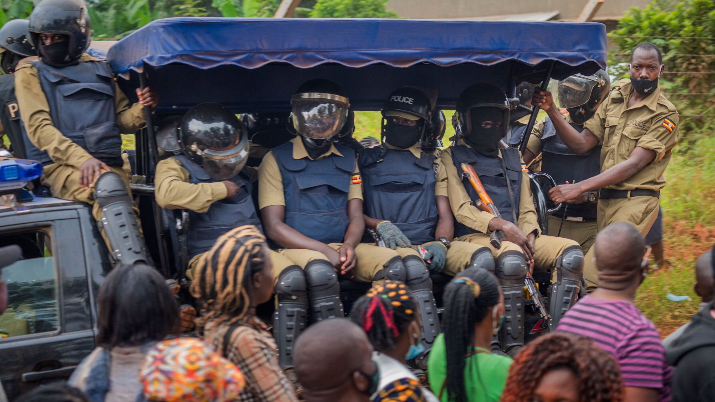 Security forces drive past a polling station in Kampala, Uganda, Jan. 14, 2021.