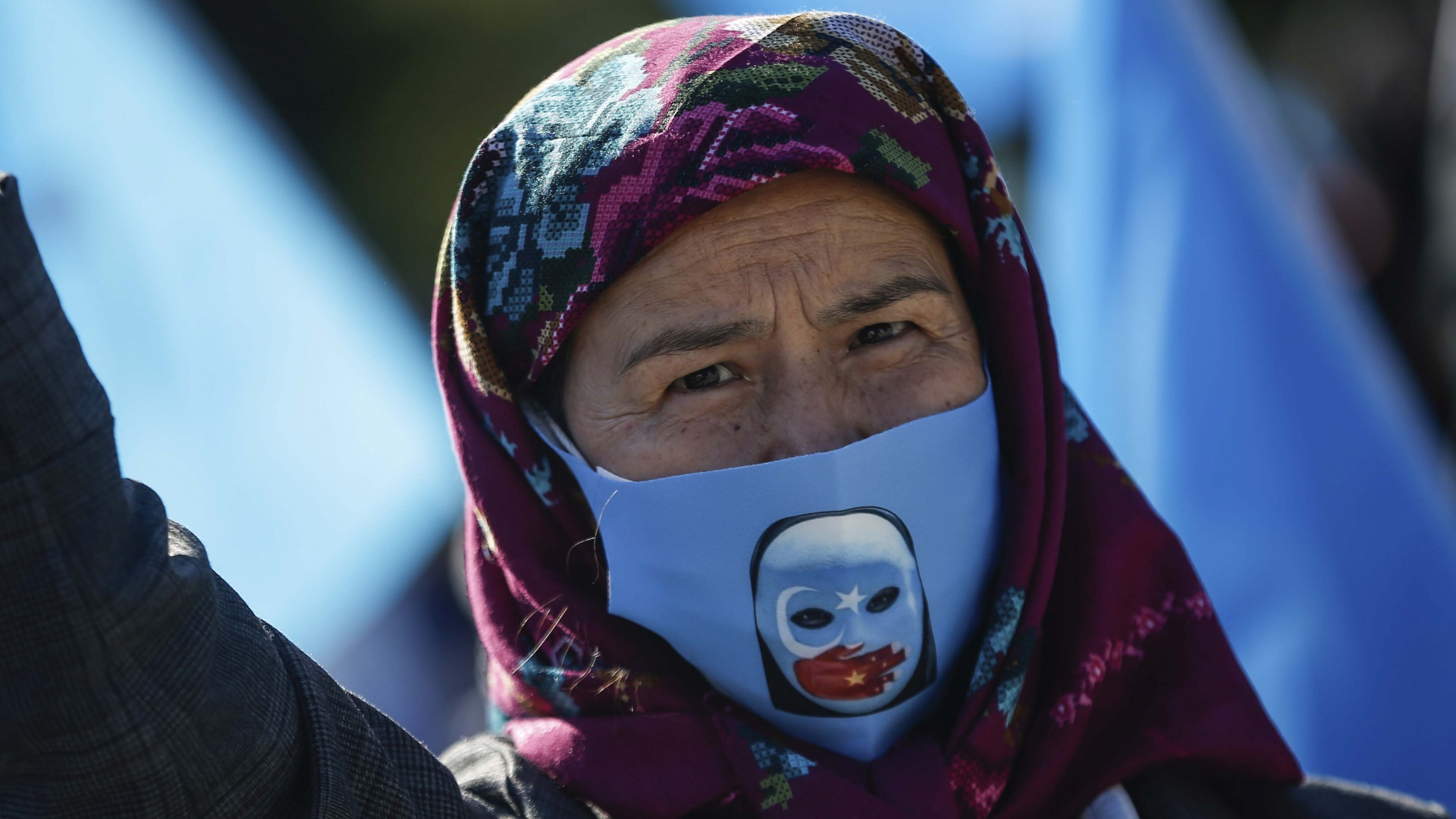 A protester from the Uighur community living in Turkey, participates in a protest in Istanbul, Oct. 1, 2020, against what they allege is oppression by the Chinese government to Muslim Uighurs in far-western Xinjiang province.