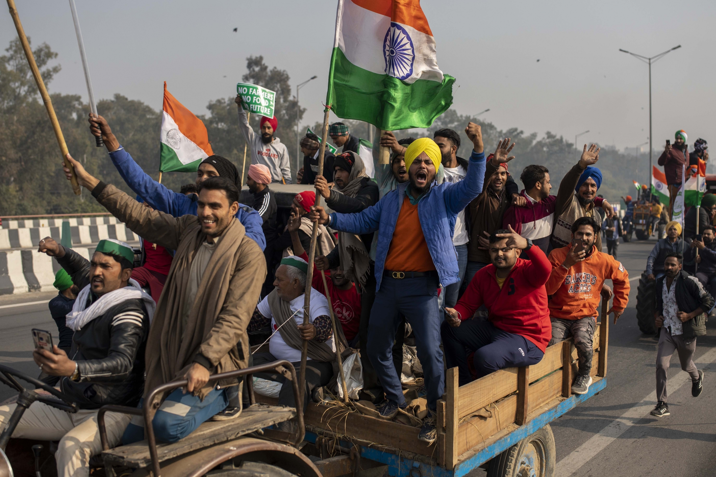 Tens of thousands of farmers drove a convoy of tractors into the Indian capital as the nation celebrated Republic Day on Tuesday in the backdrop of agricultural protests that have grown into a rebellion and rattled the government.