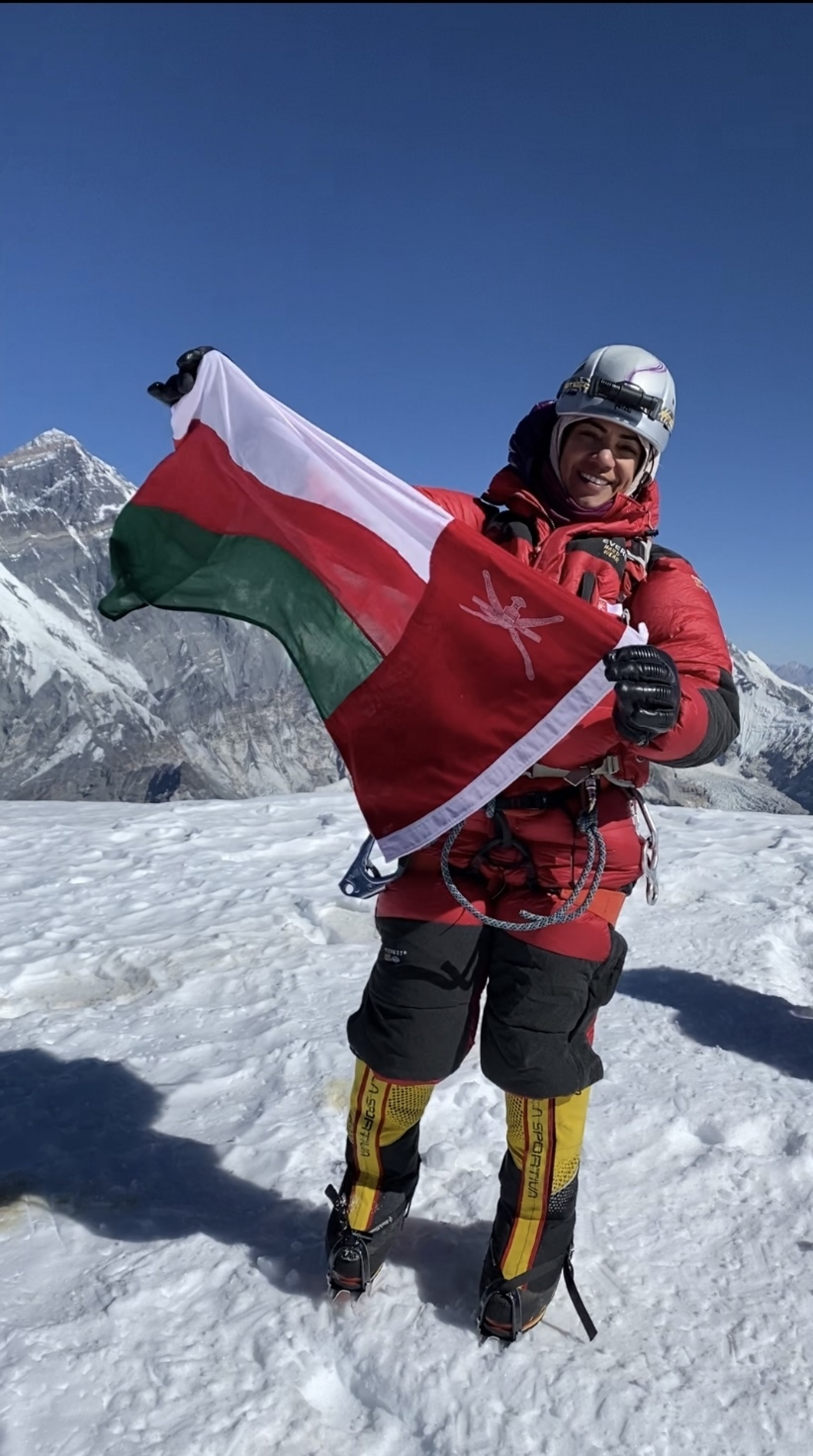 Omani climber Nadhira al-Harthy at the summit of Mt. Ama Dablam in Nepal on Jan. 14, 2021.