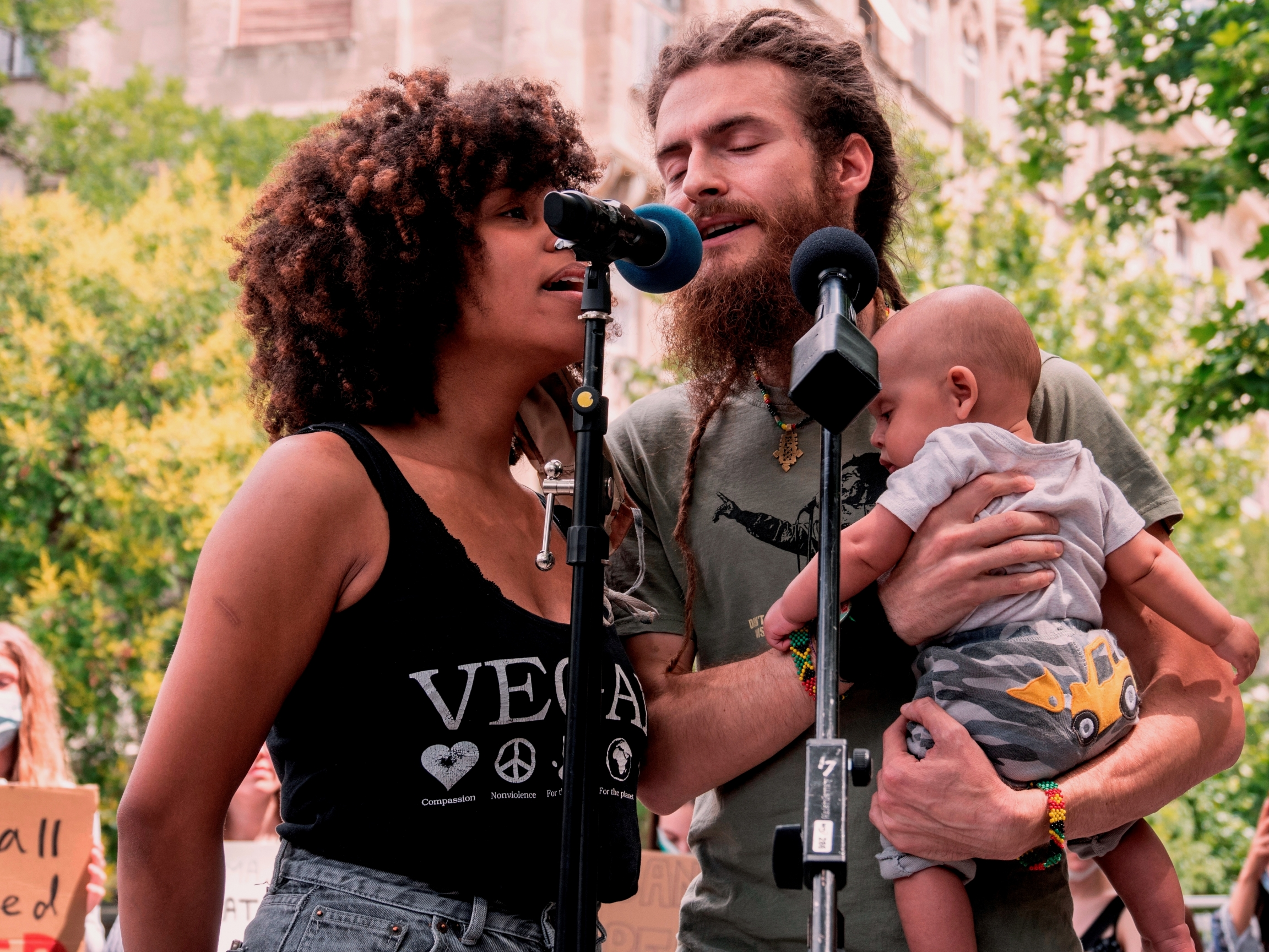 Gregory G Ras,a reggae singer and activist,organized the main Black Lives Mattermarch in Budapest last summer. His wife and baby Noah are pictured with him.