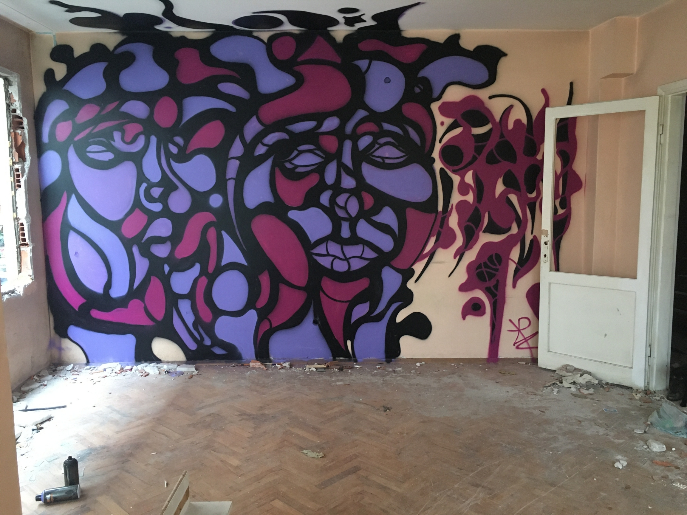 """This is """"Mikrotopya,"""" a collection of installations, graffiti art and sculptures of found items created by 16 artists in an empty, four-story apartment building slated for demolition as part of an extensive urban renewal project. The art can be found thro"""