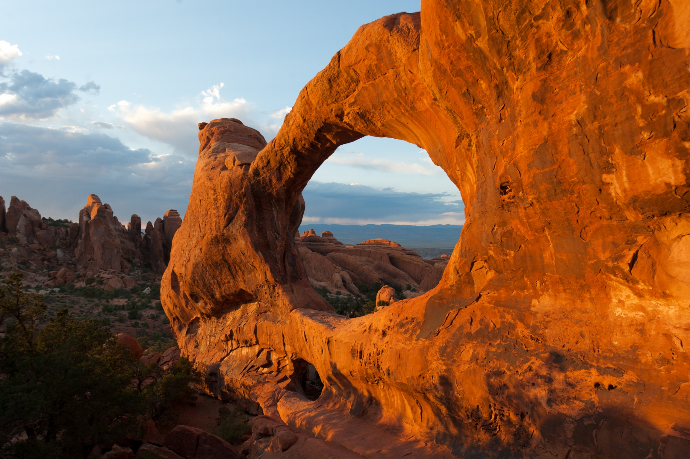 Brown arches naturally formed from stone in Arches National Park