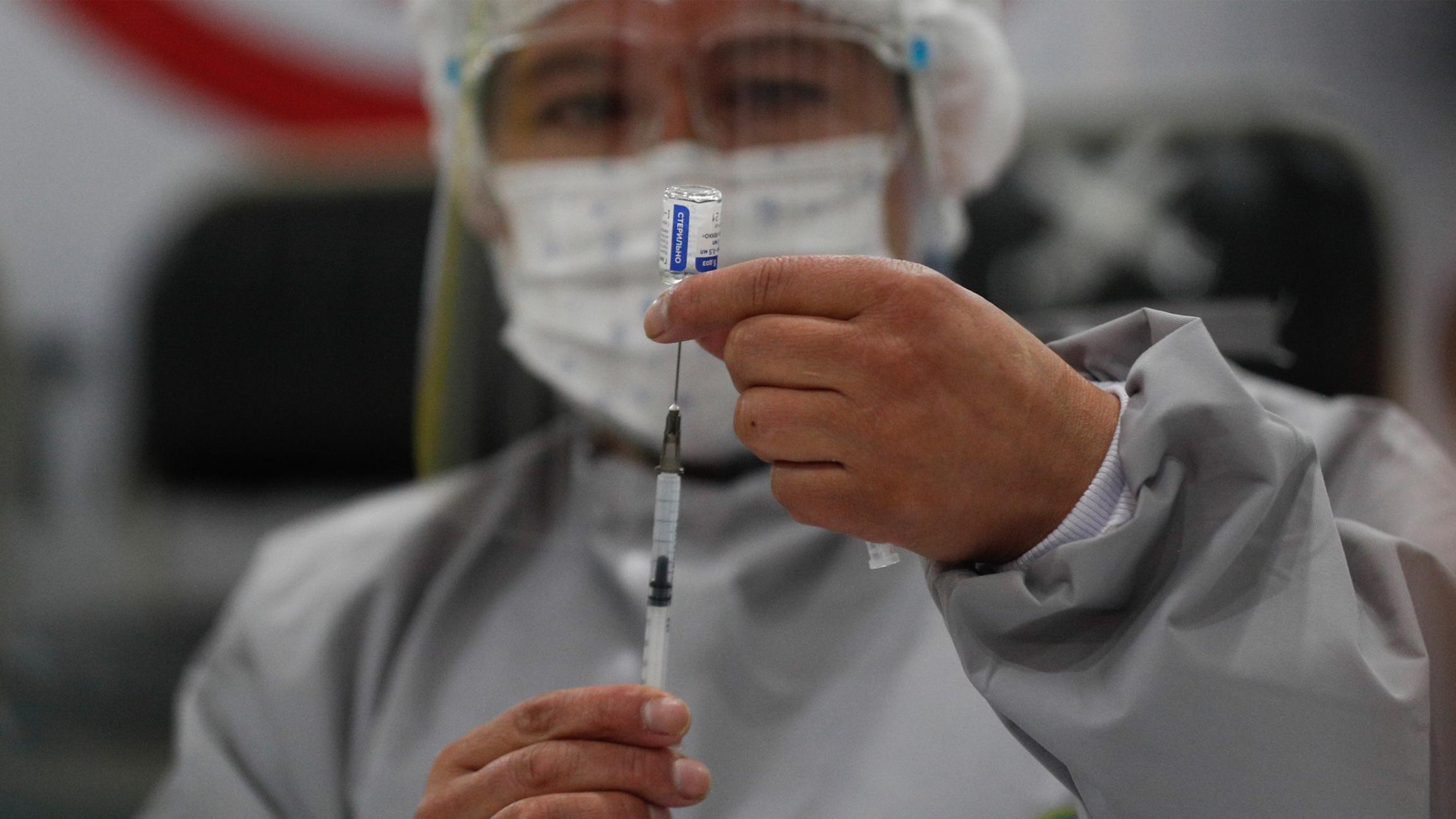 A health care worker prepares a dose of Russia's Sputnik V COVID-19 vaccine, at the Del Norte Hospital in El Alto, Bolivia,on Saturday, Jan. 30, 2021.
