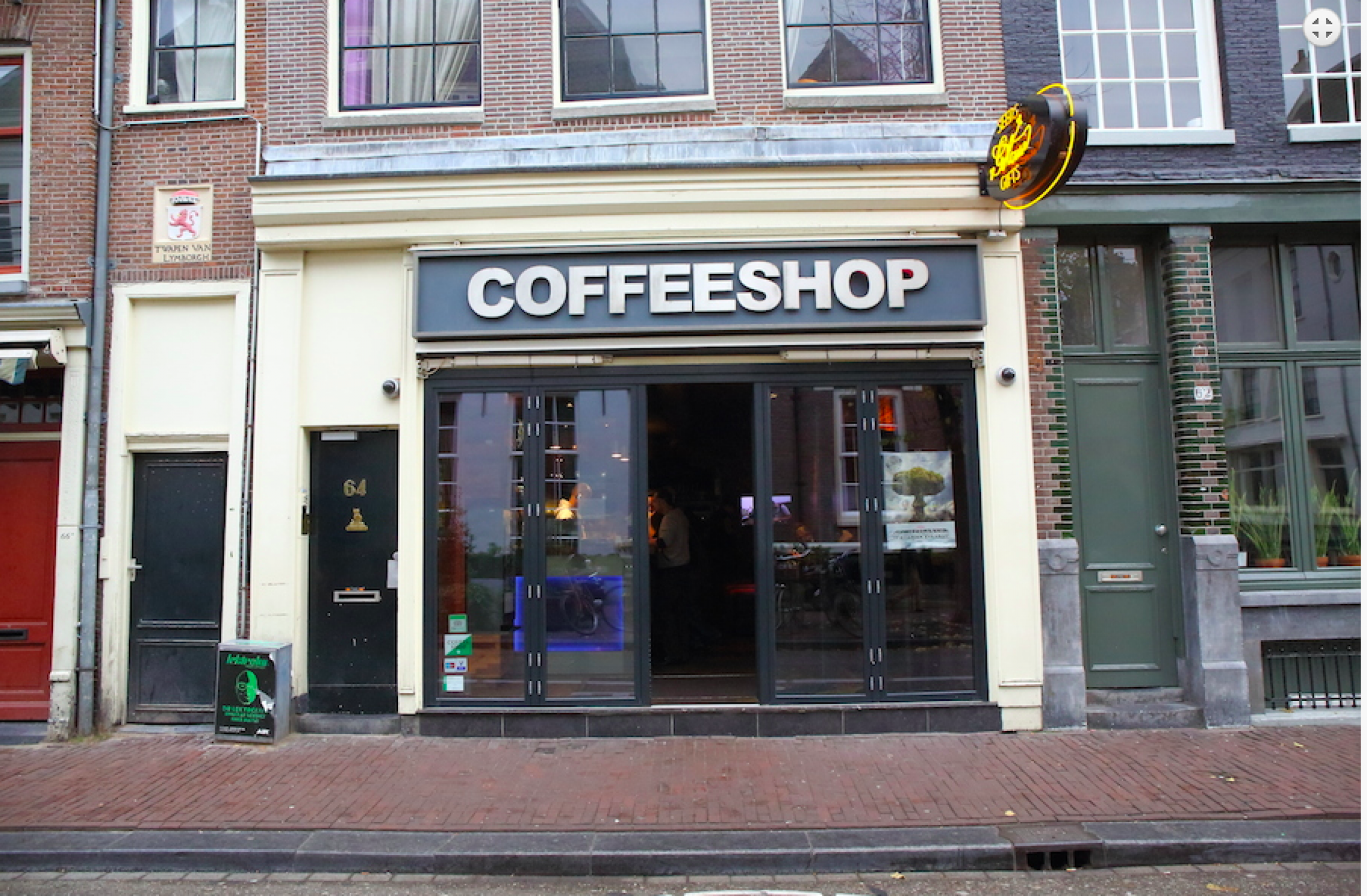 The outside facade of a Green House coffee shop in Amsterdam, Netherlands.
