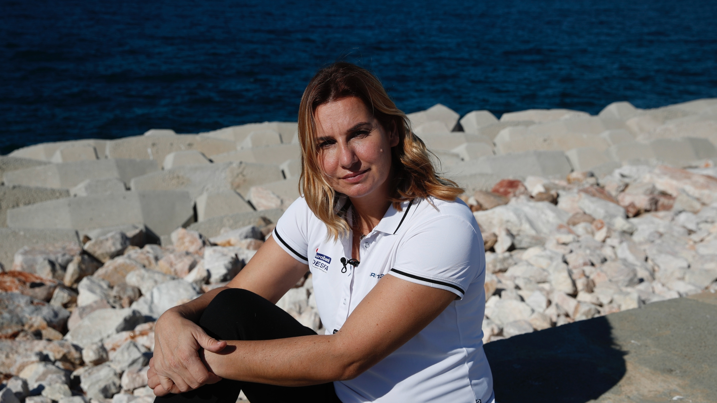 Greek Olympic sailing champion Sofia Bekatorou poses for a photograph during an interview for The Associated Press, at Agios Kosmas marina in southern Athens, Feb. 4, 2021. Bekatorou is the most successful female athlete in Greek sporting history who rece