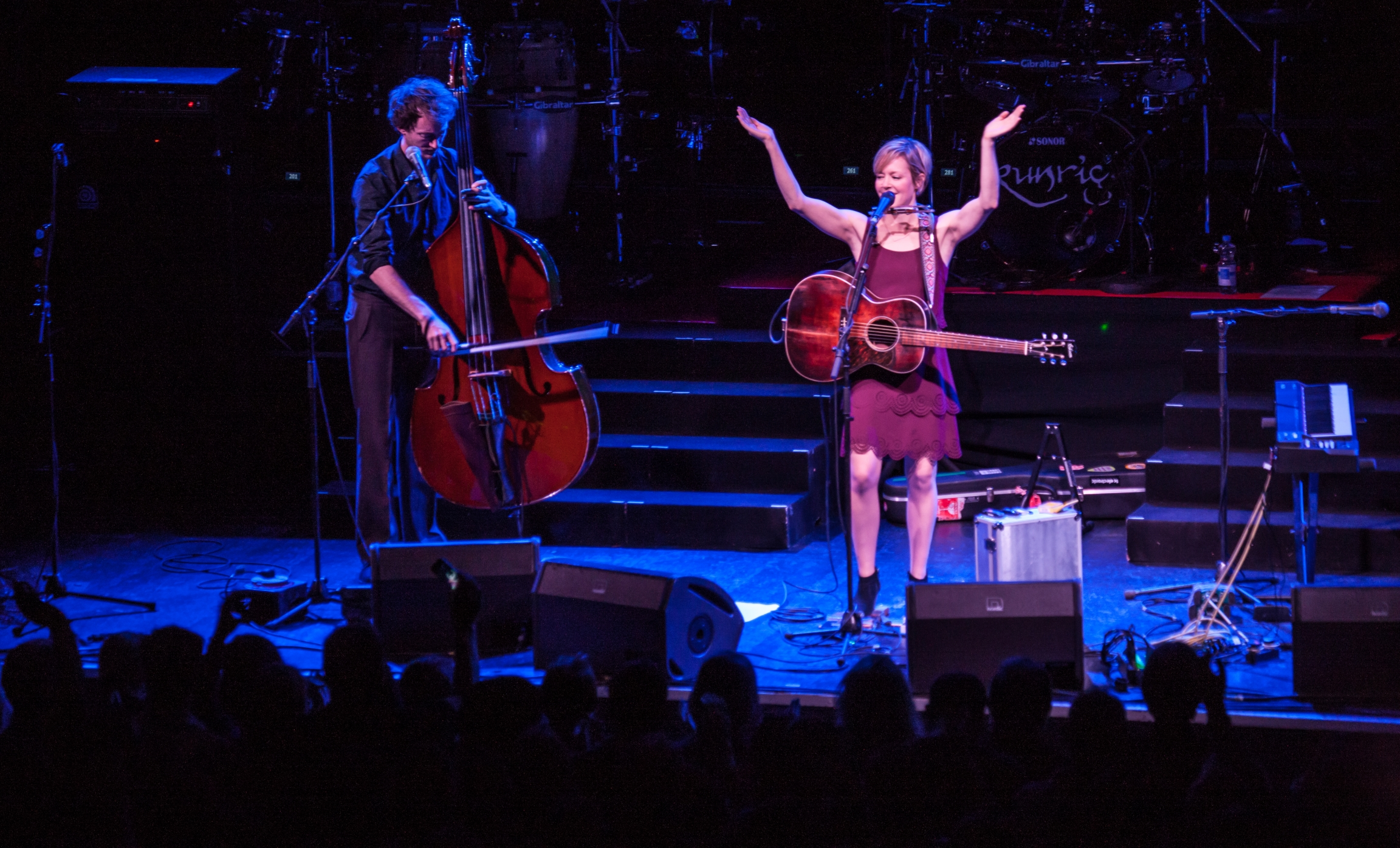 Emily Barker is shown onstage. More recently, the British musician streamed a live concert without an audience from a local music venue.