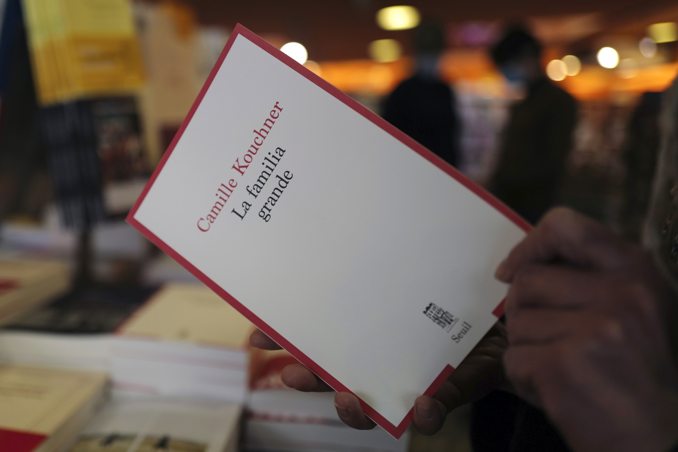 A person holds a book in their hands