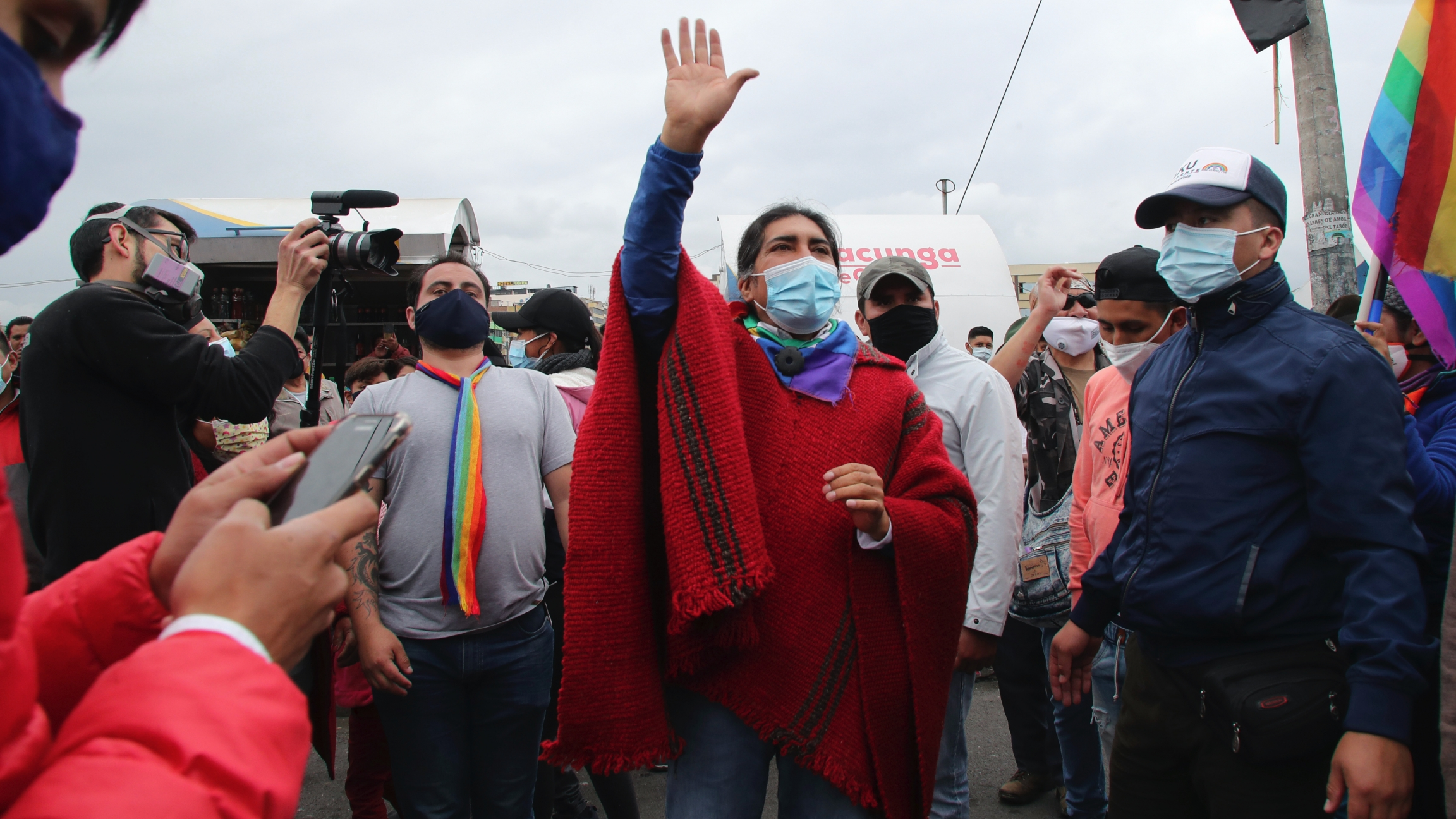 Presidential candidate Yaku Pérez greets supporters as he leads a protest march to Quito, in Latacunga, Ecuador, Feb. 22, 2021. Pérez, who came in a close third in the recent elections, has alleged fraud after the results indicated he had fallen just shor