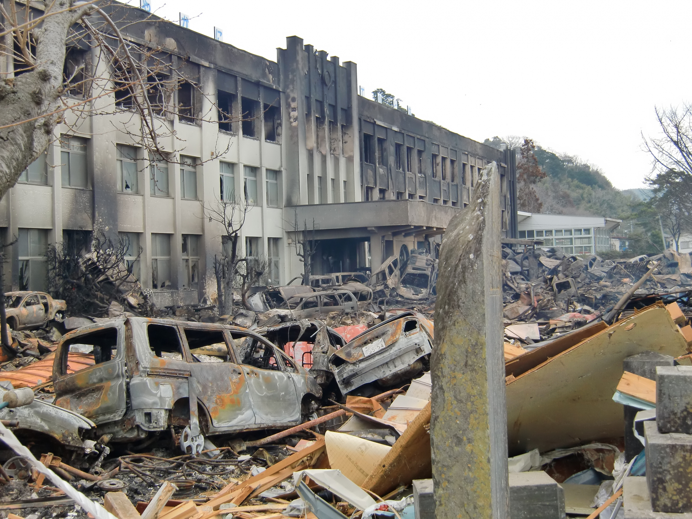 A school is shown completely burned out with no windows.