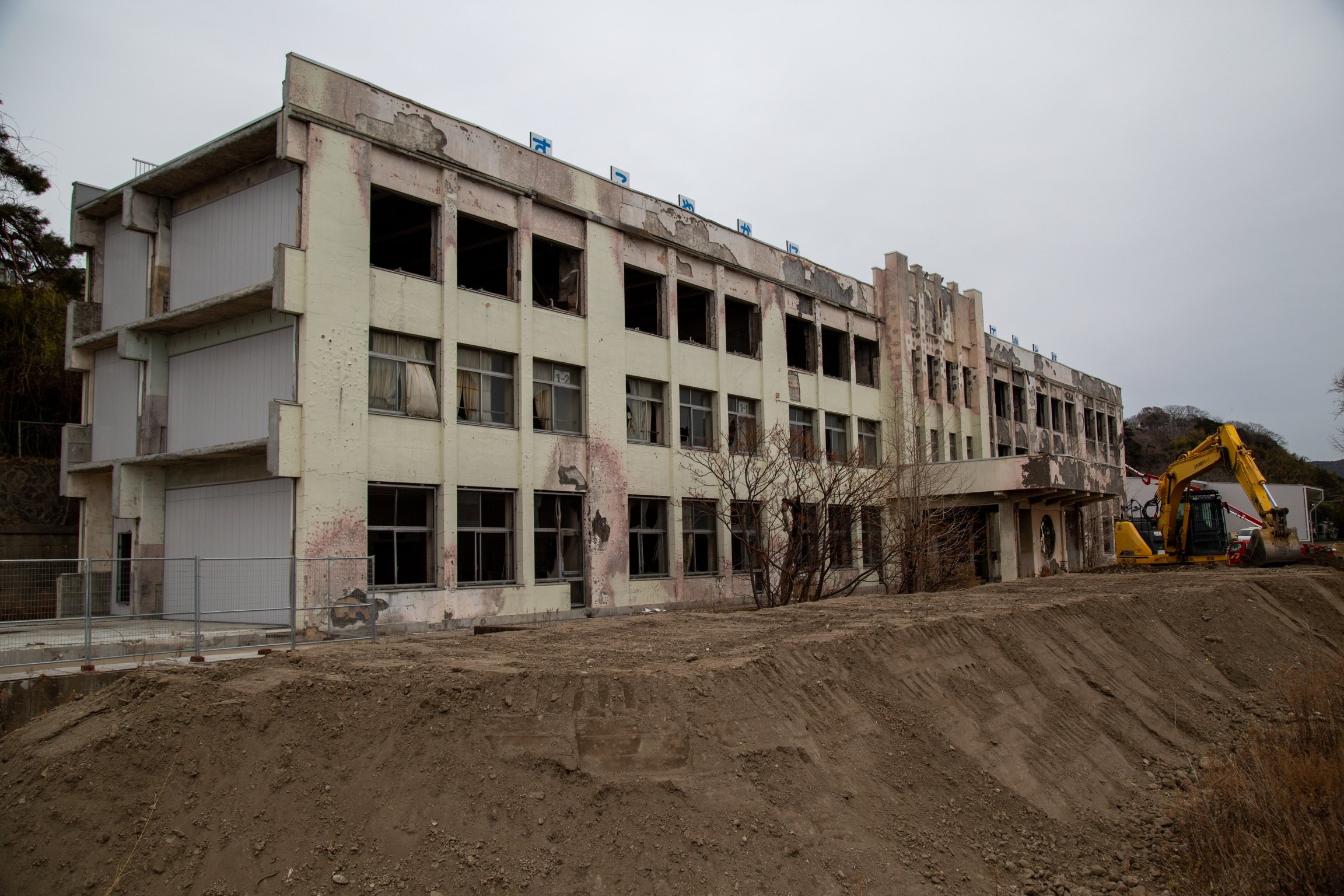 A school is shown burned with a crane at one end.