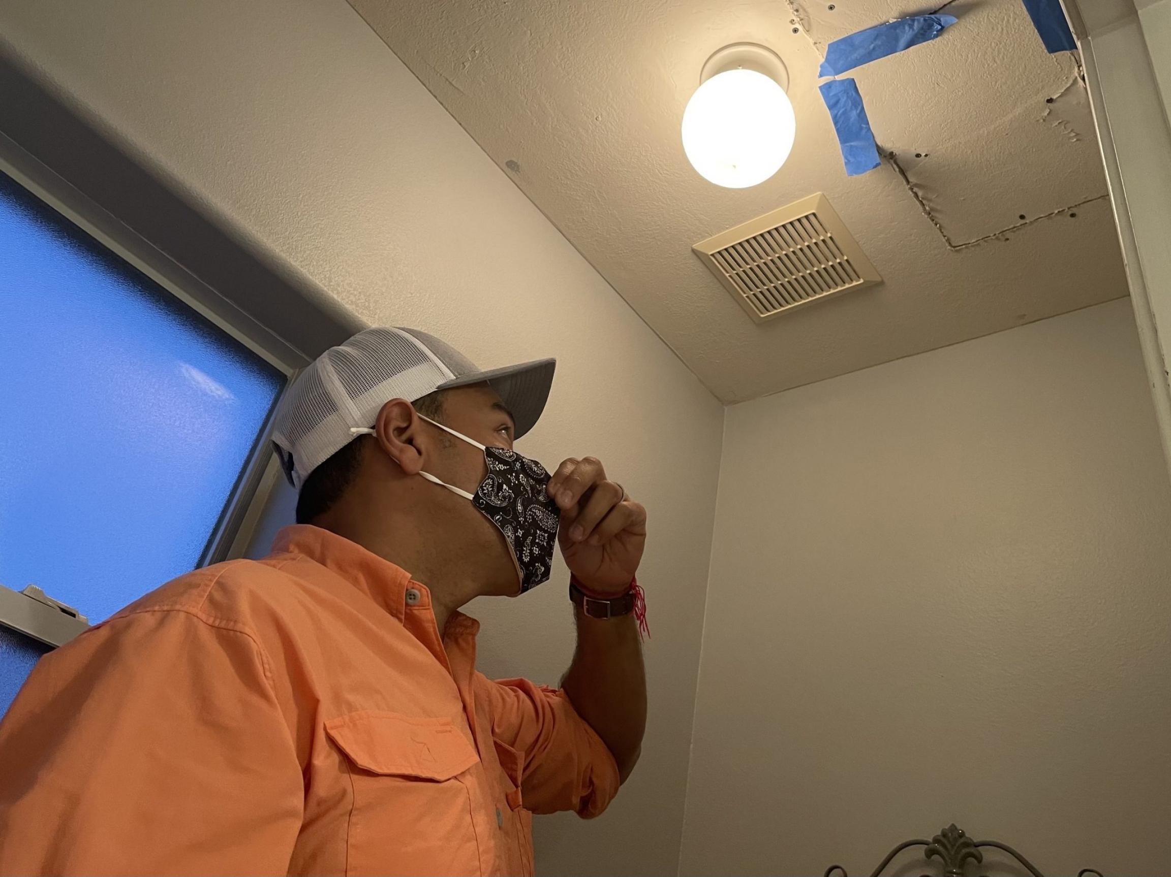 Houston plumber Eduardo Dolande shows where pipes burst inside his own home during the Texas freeze.