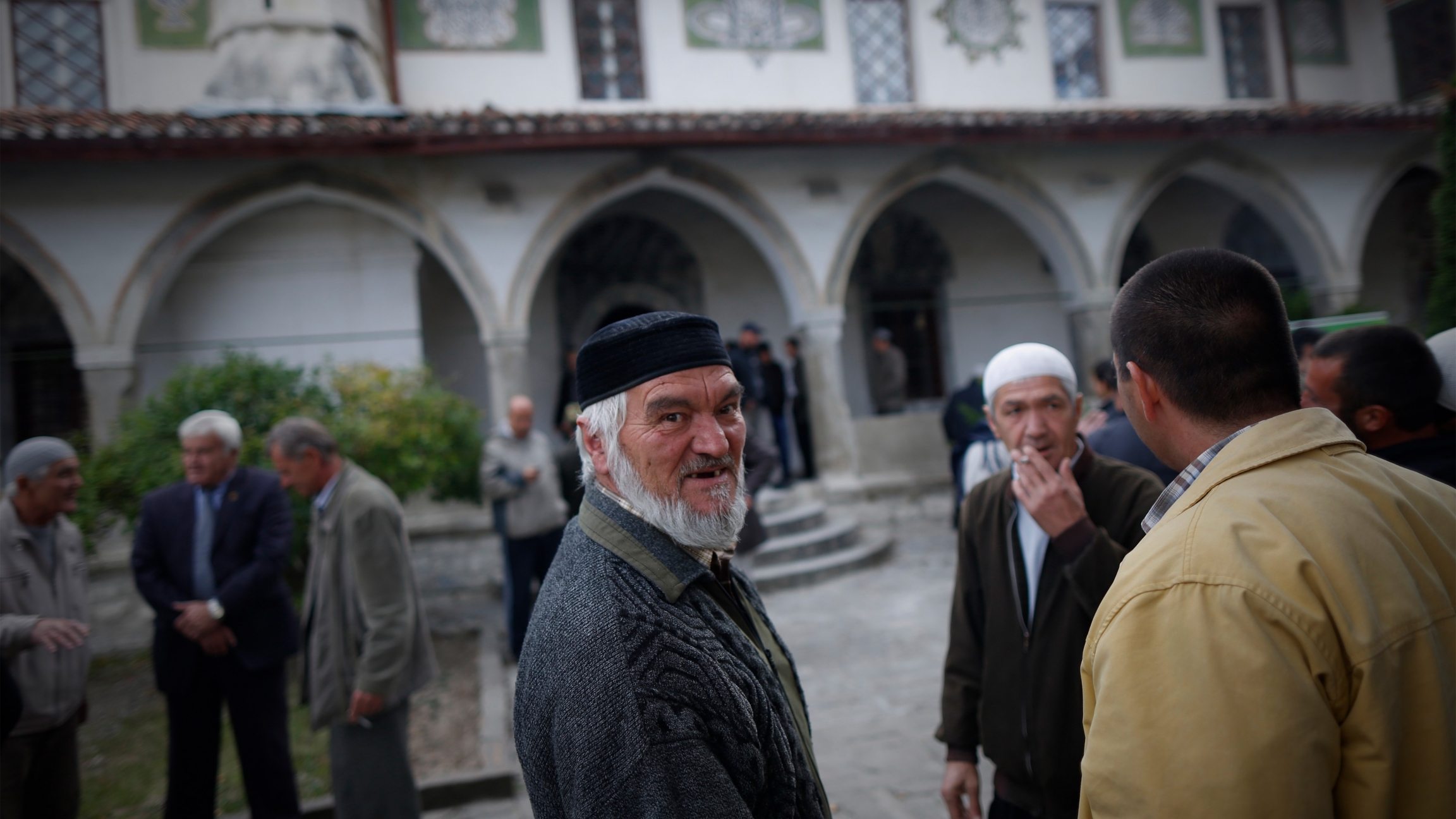 Crimean Tatars speak after the prayer in a Mosque marking the Eid al-Adha, celebrated by Muslims worldwide, in Bakhchisarai, Crimea, on Sat.Oct. 4, 2014.