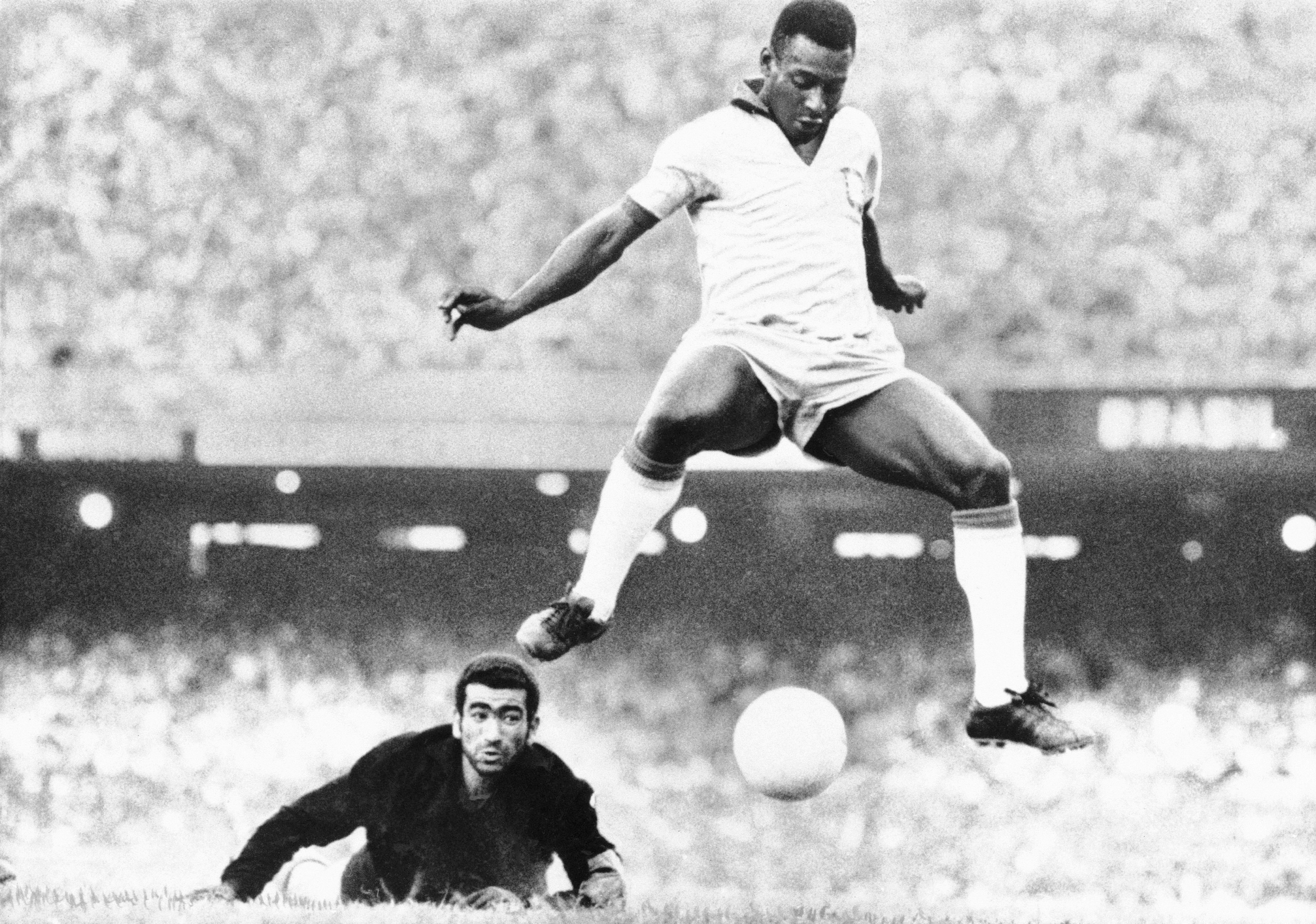 Black-and-white photo of Pele getting ready to shoot a soccer ball into the net