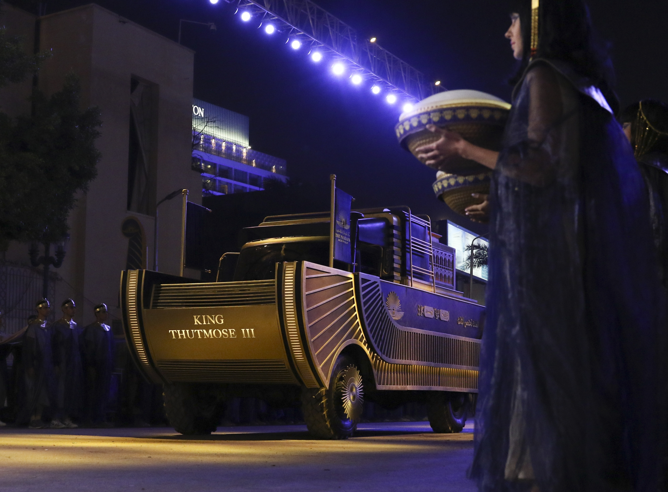 A convoy of vehicles transporting royal mummies is seen in Cairo, April 3, 2021. Egypt held a parade celebrating the transport of 22 of its prized royal mummies from the Egyptian Museum to the newly opened National Museum of Egyptian Civilization.
