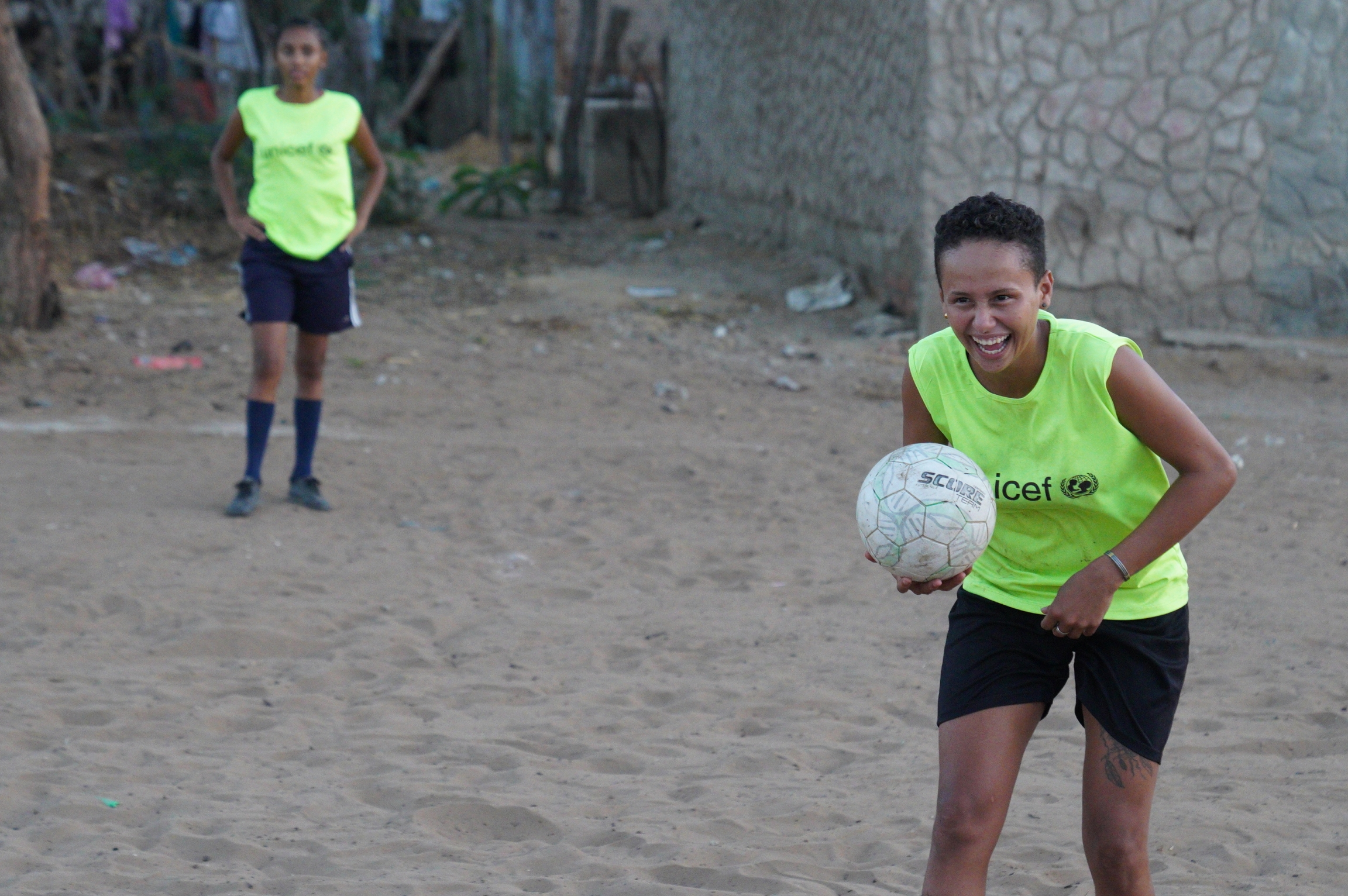Maria Isabel Parra, 21, says that playing kick ball helps her to meet new people and deal with some of the stressthat comes with being an unemployed migrant.