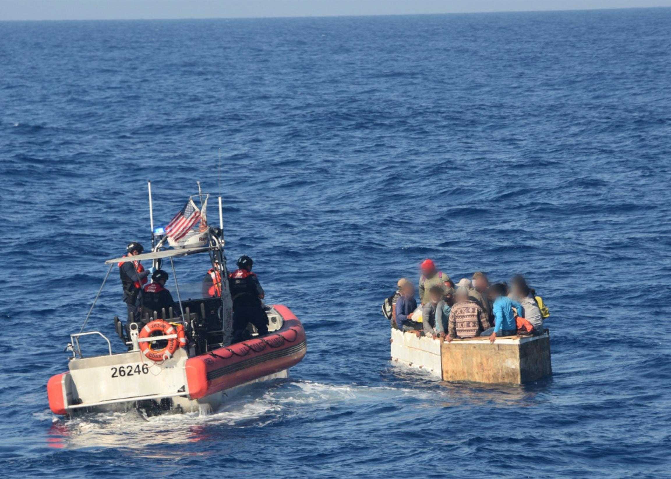 People on rafts at sea