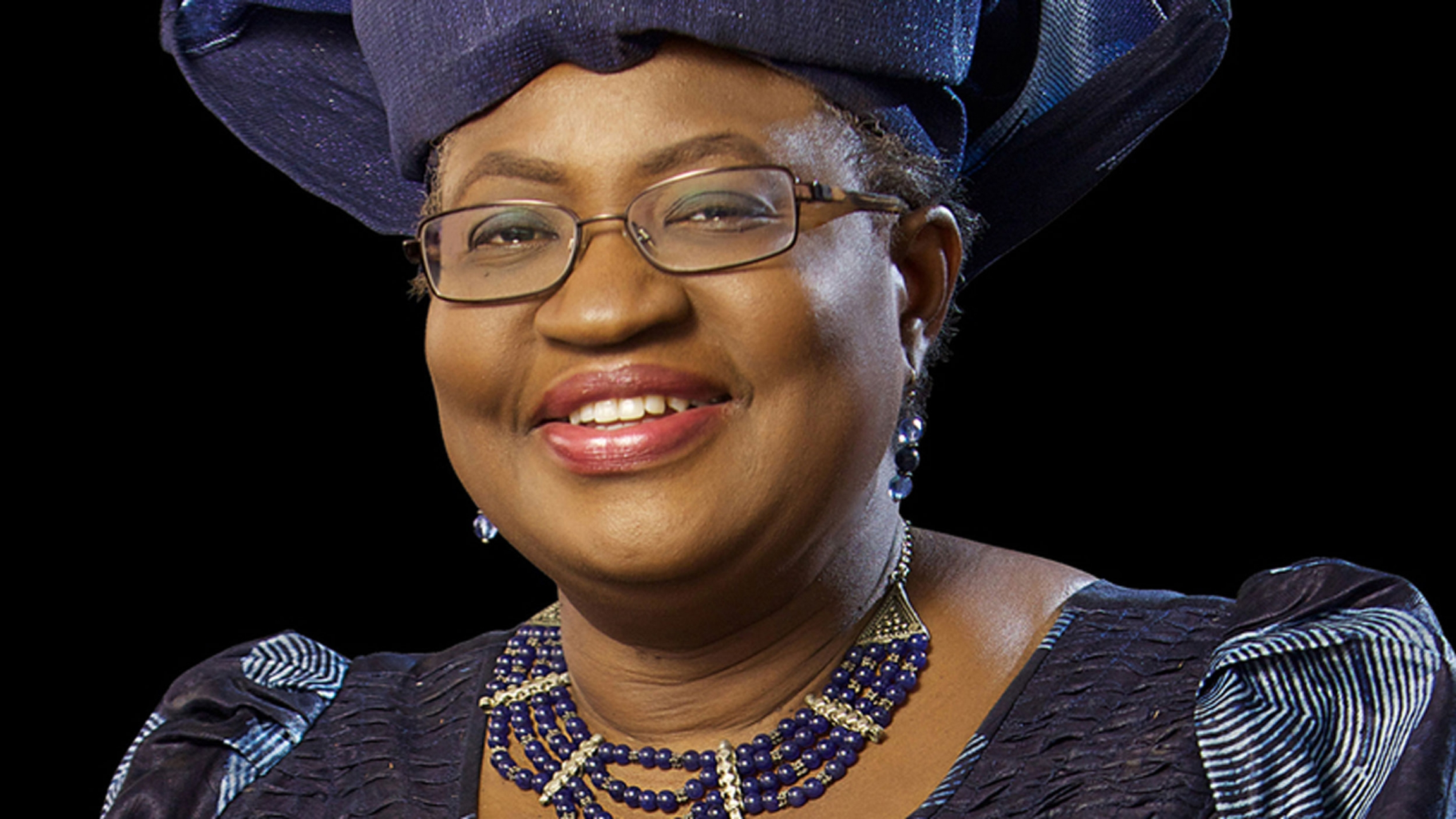 Author Ngozi Okonjo-Iweala poses for the camera in a dark blue outfit