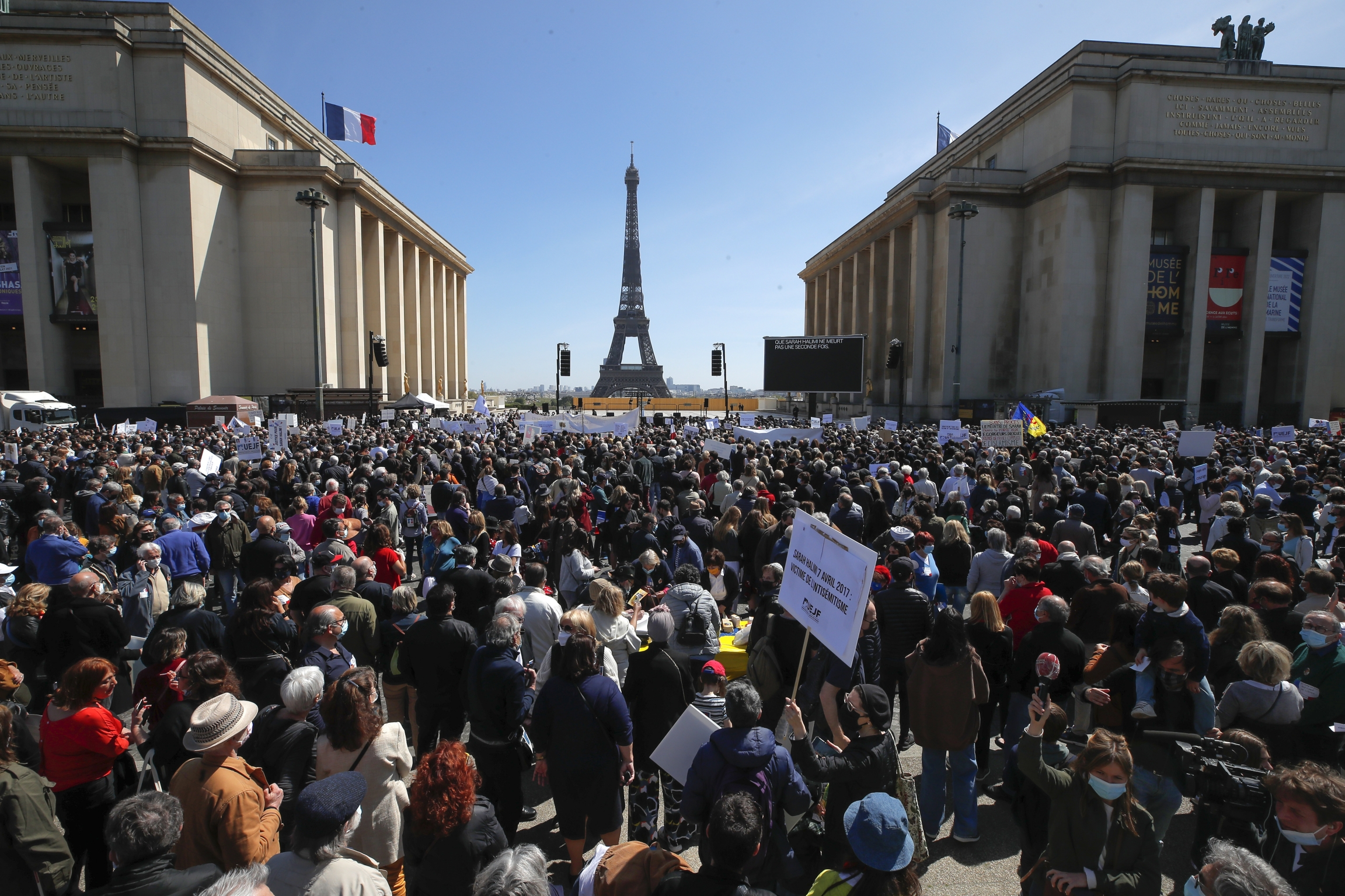 People stage a protest organized by Jewish associations, who say justice has not been done for the killing of French Jewish woman Sarah Halimi, at Trocadero Plaza near Eiffel Tower in Paris, Sunday, April 25, 2021.