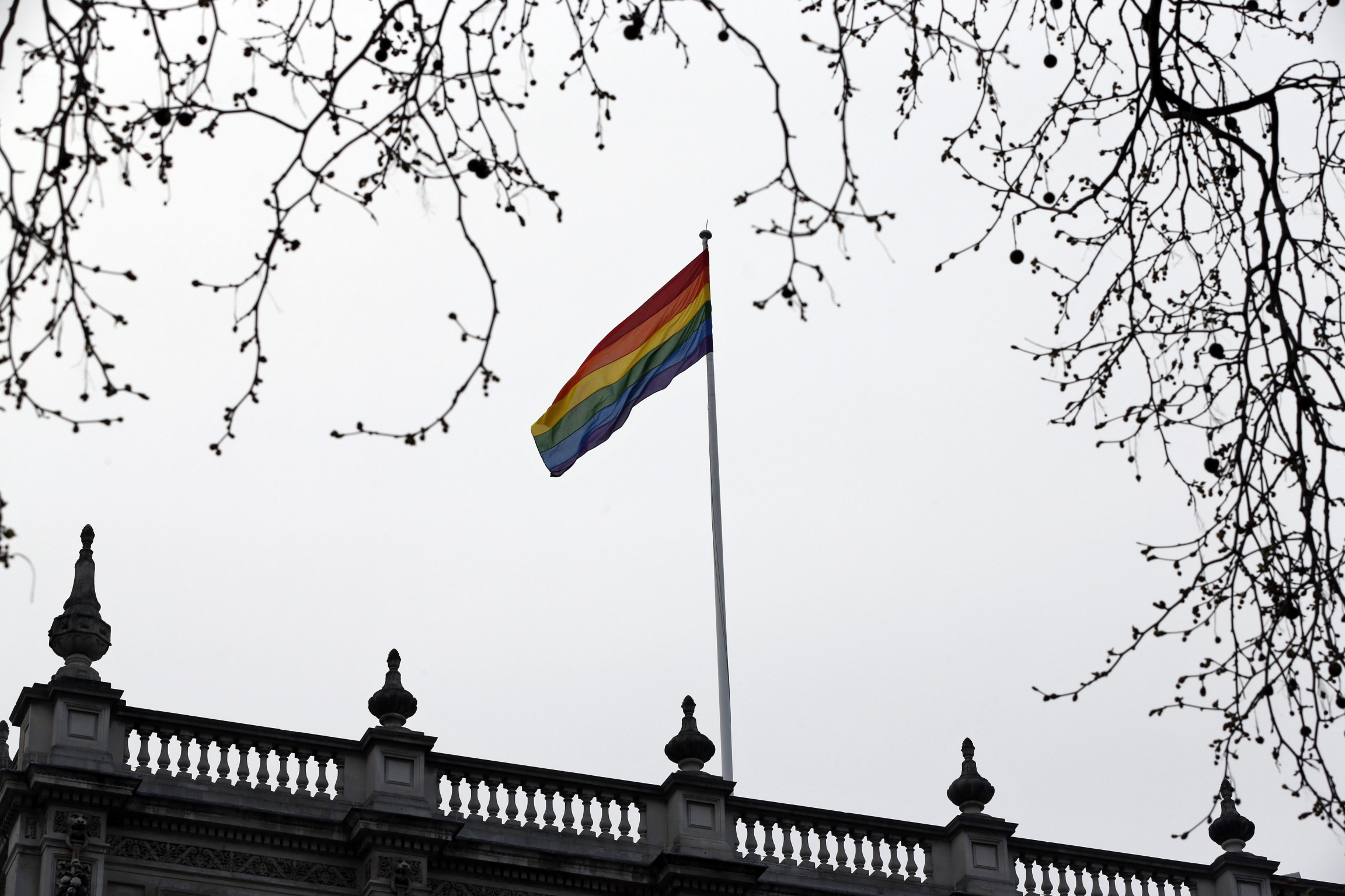 The rainbow flag, a symbol of the lesbian, gay, bisexual, and transgender community, flies over the British Government Cabinet Offices building, in central London, Friday, March 28, 2014.