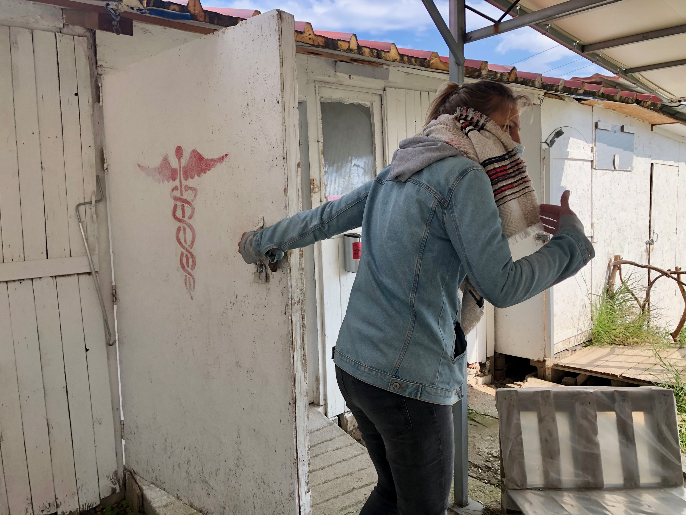 Tyra Eklund, mental health coordinator for Mental Volunteers International on Lesbos, enters MVI's clinic. MVI's programs, which are at capacity, support approximately 100 refugee children and adults, in groups and one-on-one.