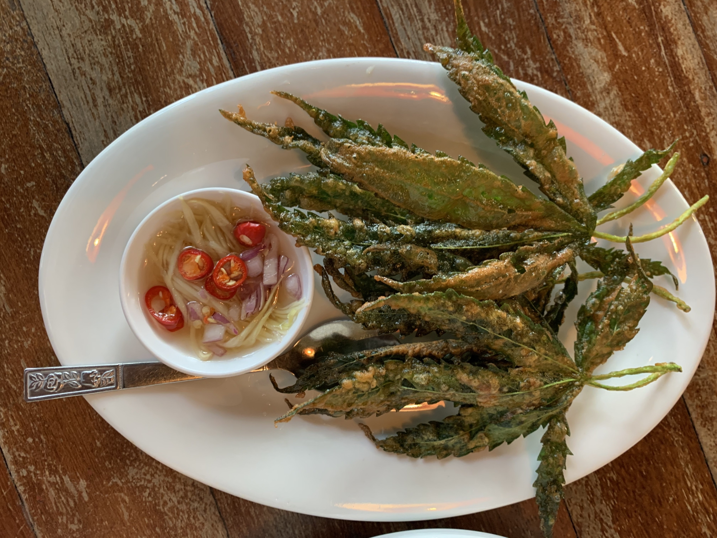 Cannabis leaves are incorporated into dishes at arestaurant called Baan Lao Ruang (The Storytelling House) in a rural area outside of Bangkok.