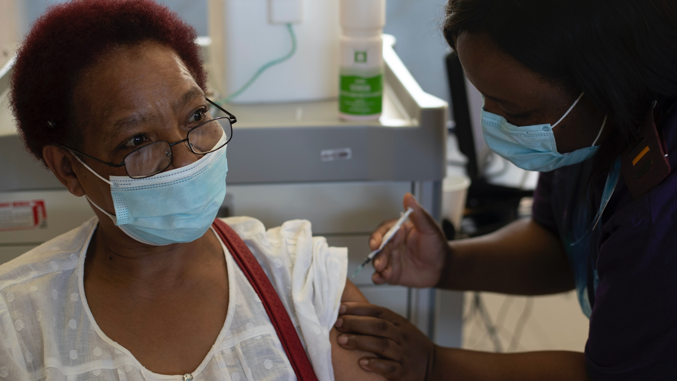 Health care worker Maggie Sedidi receives a Johnson & Johnson COVID-19 vaccine at a vaccination center in Soweto, South Africa, March 5, 2021.