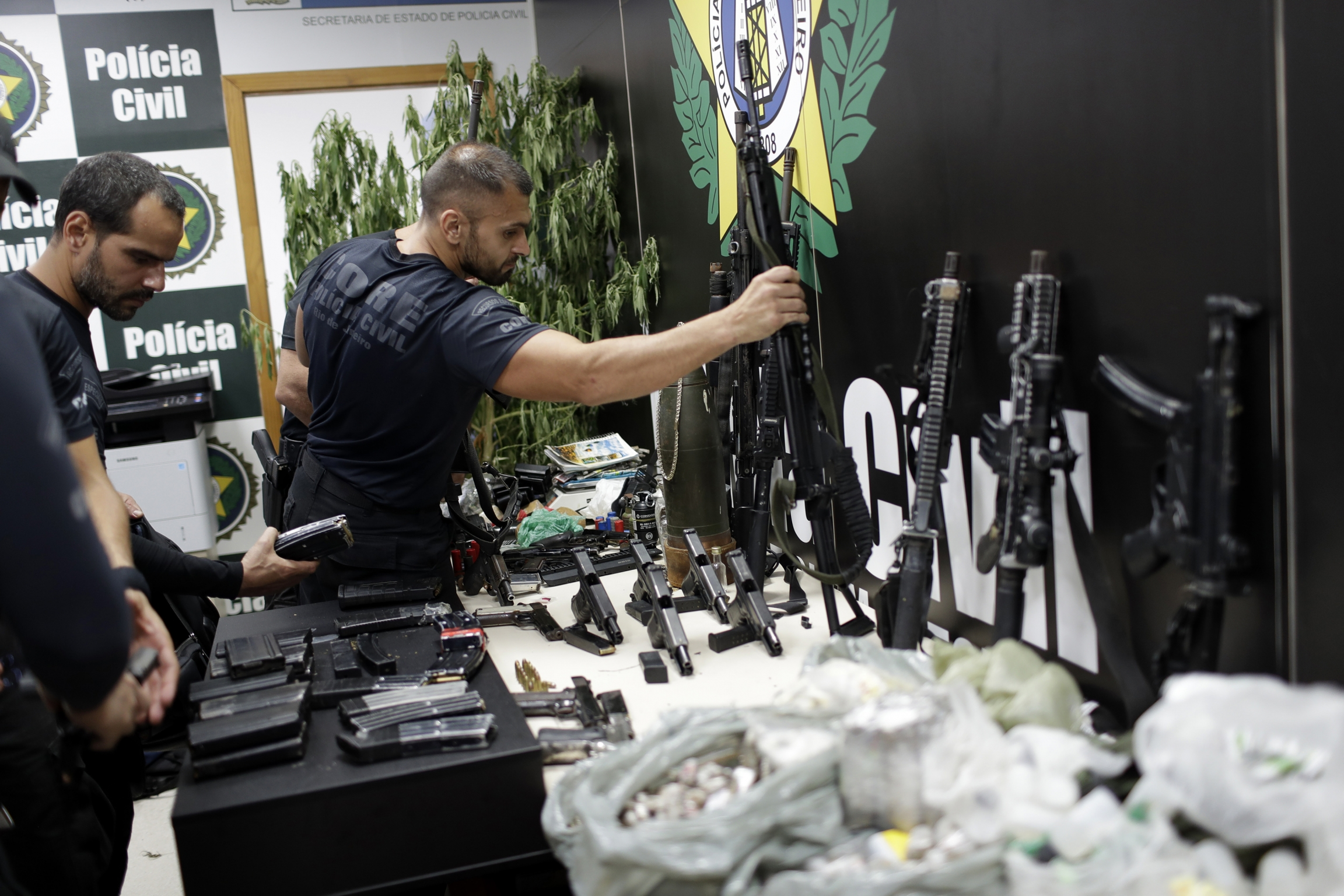 Weapons and drugs seized during a police raid are displayed for the press at city police headquarters in Rio de Janeiro, Brazil, May 6, 2021.