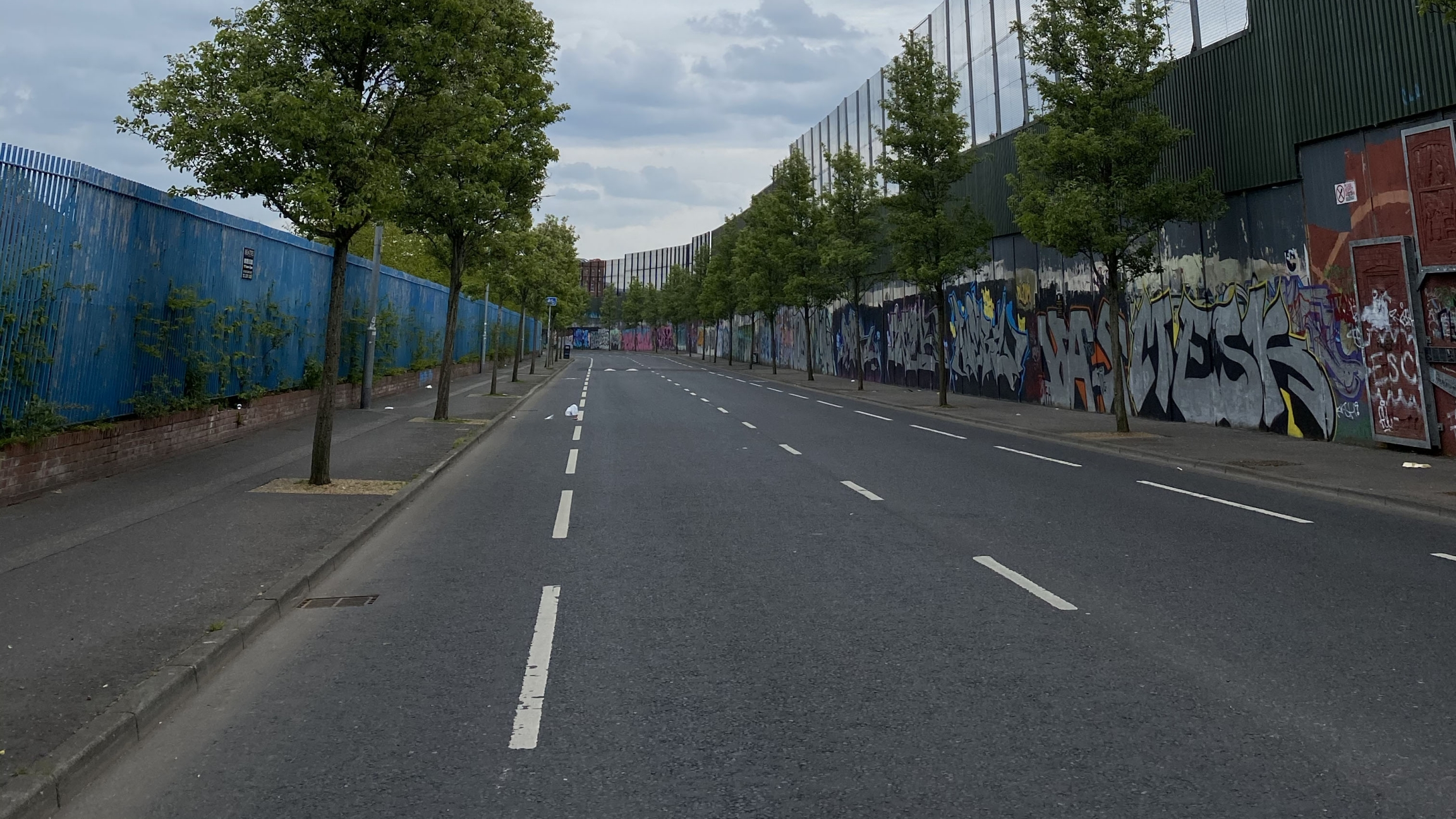 """One of the so-called """"peace walls"""" that divide Protestant and Catholic areas of west Belfast."""