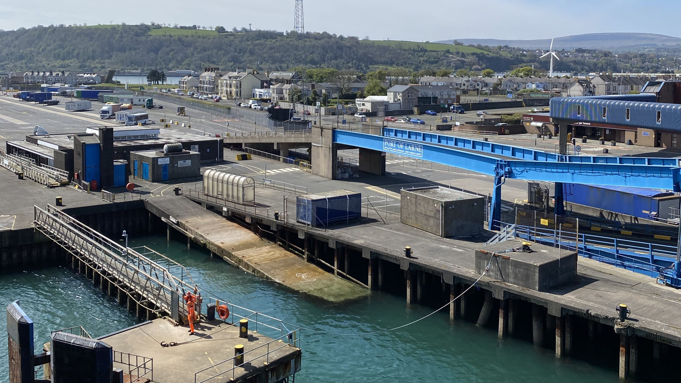 Larne port stretches out into the waters with shipping containers.
