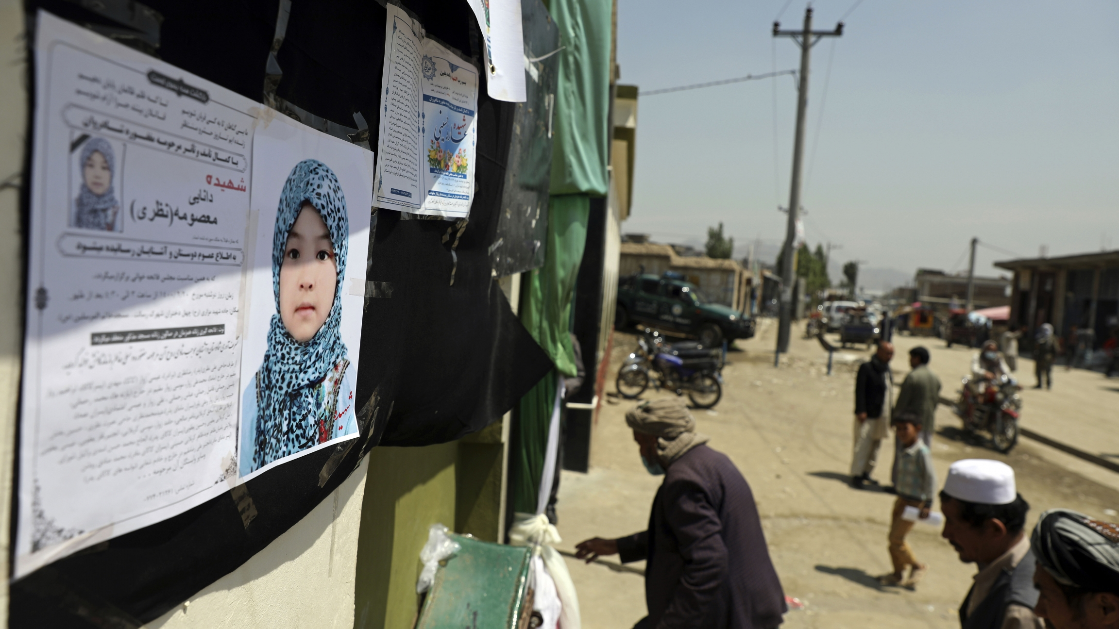 Afghans arrive at a memorial ceremony for Masooma Nazari, a student who was killed by deadly bombings on Saturday.
