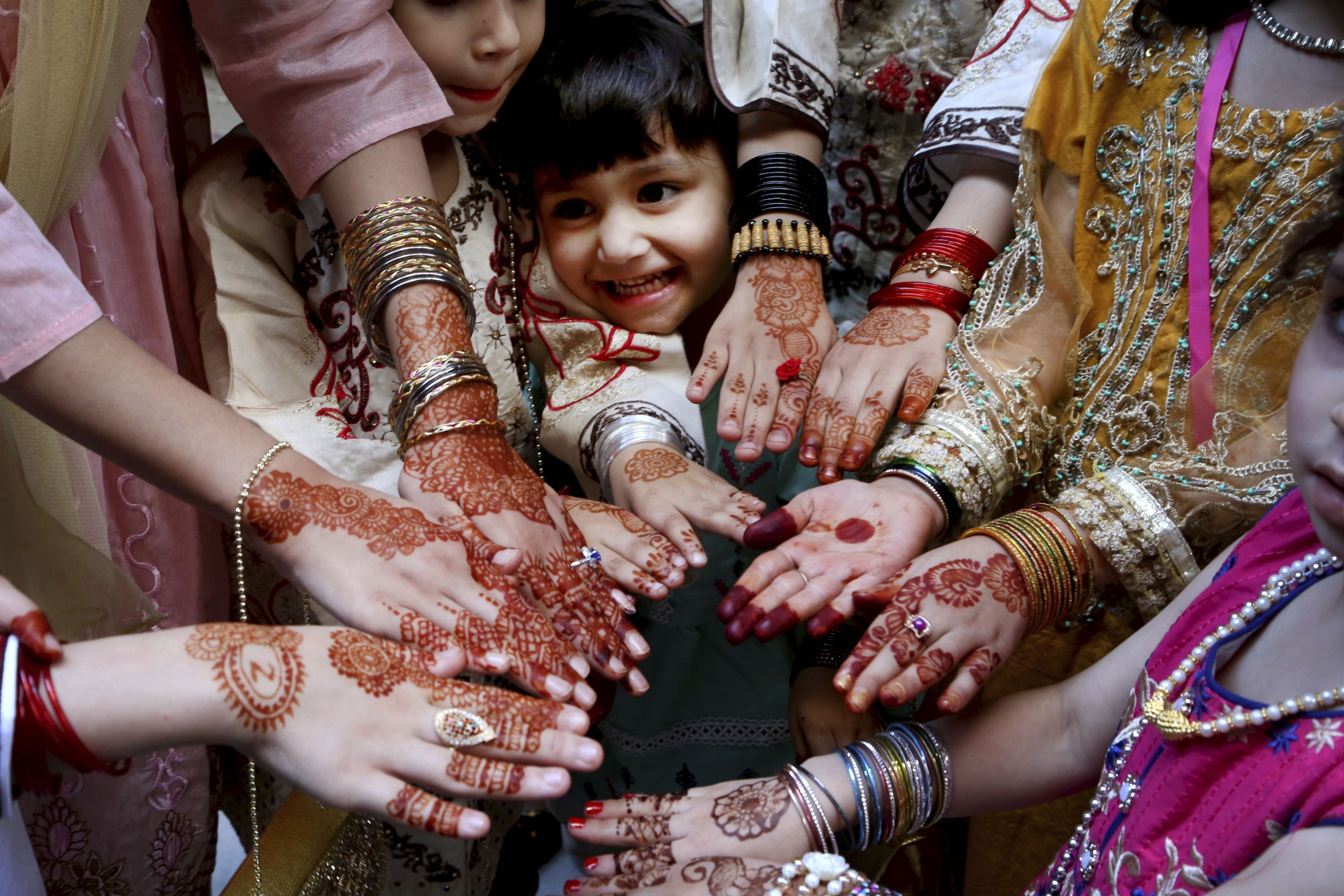 Muslimgirls display their hands painted with traditional henna to celebrate Eid al-Fitr holidays, marking the end of the fasting month of Ramadan, in Peshawar, Pakistan.