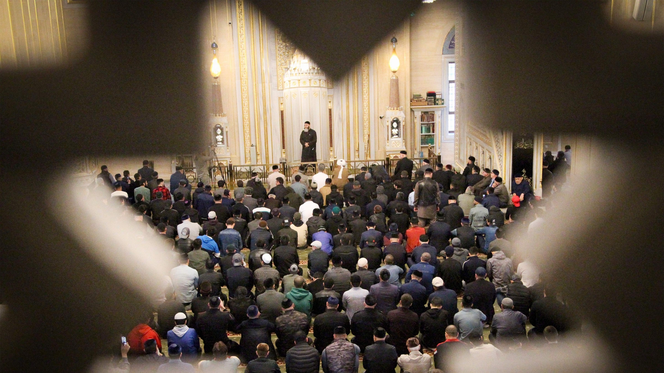 Muslims pray in a mosque during celebrations of Eid al-Fitr holiday, a feast celebrated by Muslims worldwide, in Grozny, Russia, on Thursday, May 13, 2021.