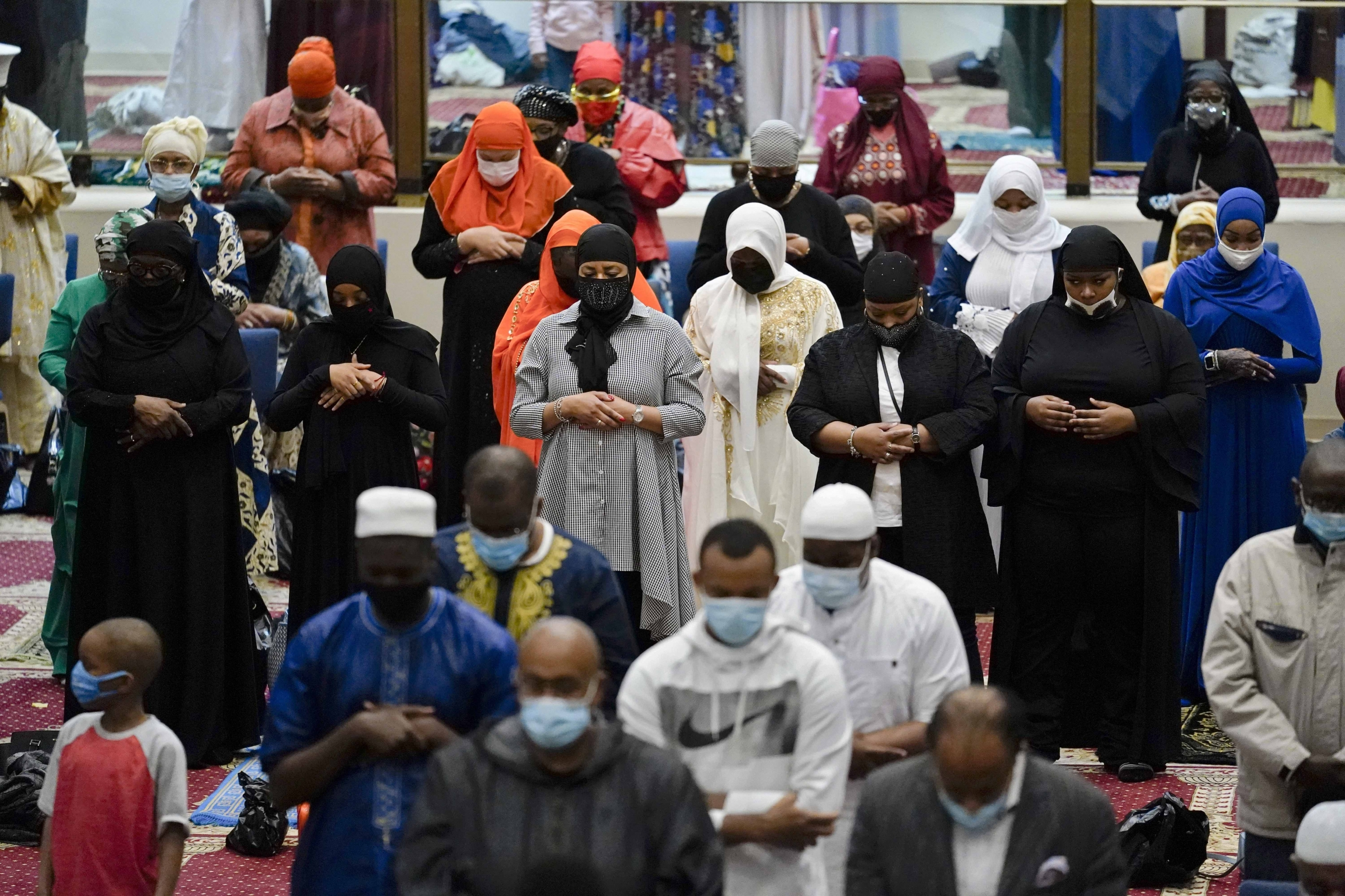 Worshippers perform an Eid al-Fitr prayer at the Masjidullah Mosque in Philadelphia, on Thursday, May 13, 2021