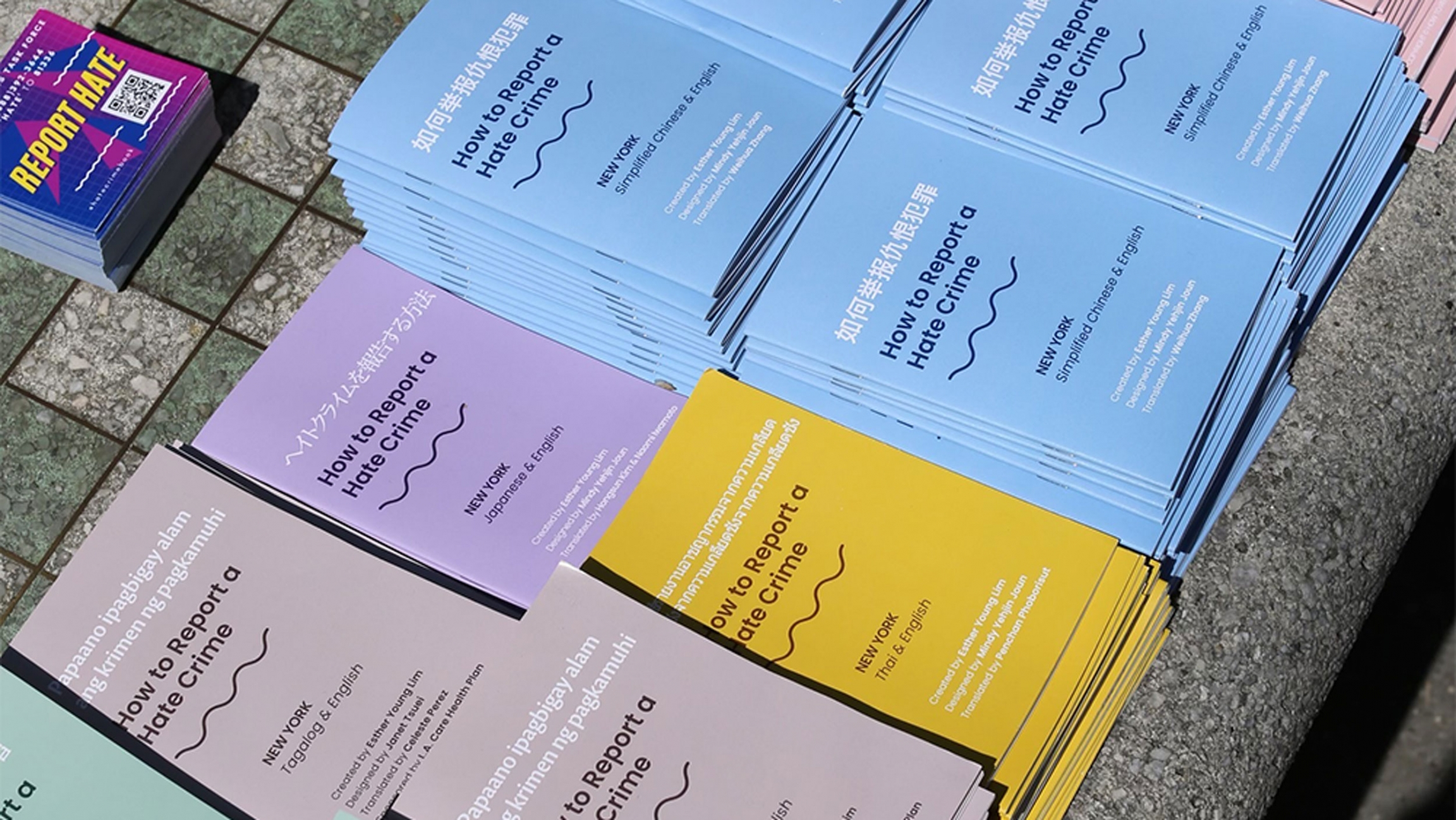 Colorful booklets in Asian languages on 'How to Report a Hate Crime'
