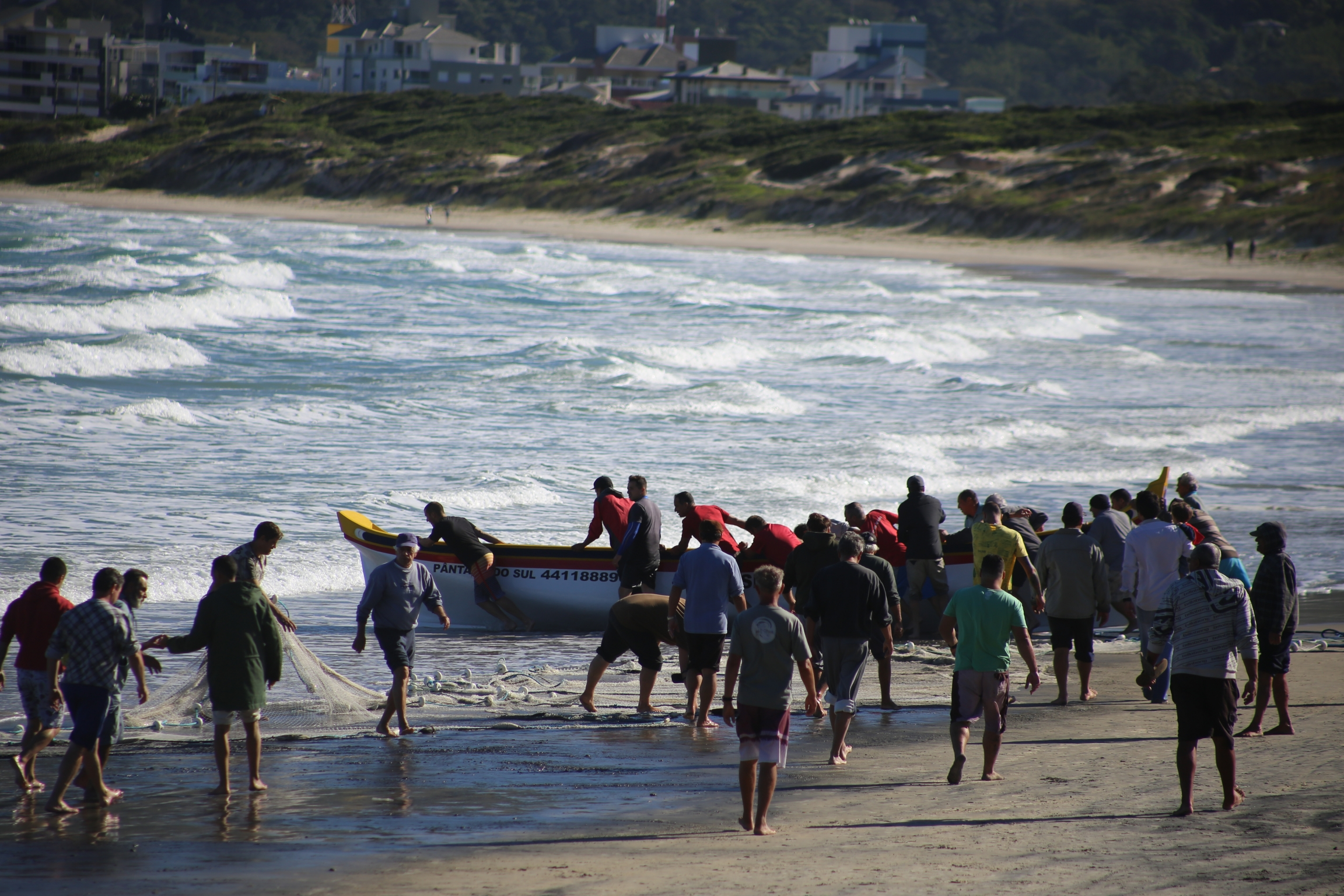 Fisherfolk meet at the sea to catch tainha in Pantano do Sul, Brazil.