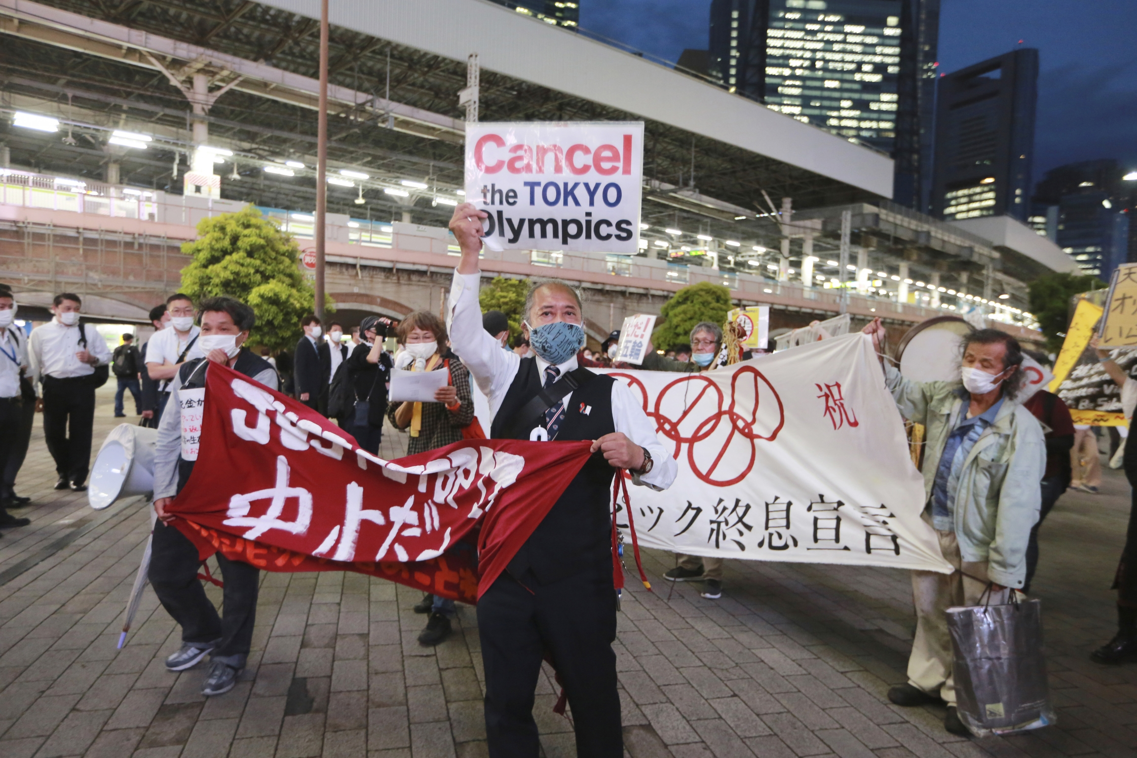 In this May 17, 2021, demonstrators protest against the Tokyo 2020 Olympics in Tokyo. The IOC and Tokyo Olympic organizersrun into some of the strongest medical-community opposition so far with the games set to open in just over eight weeks.