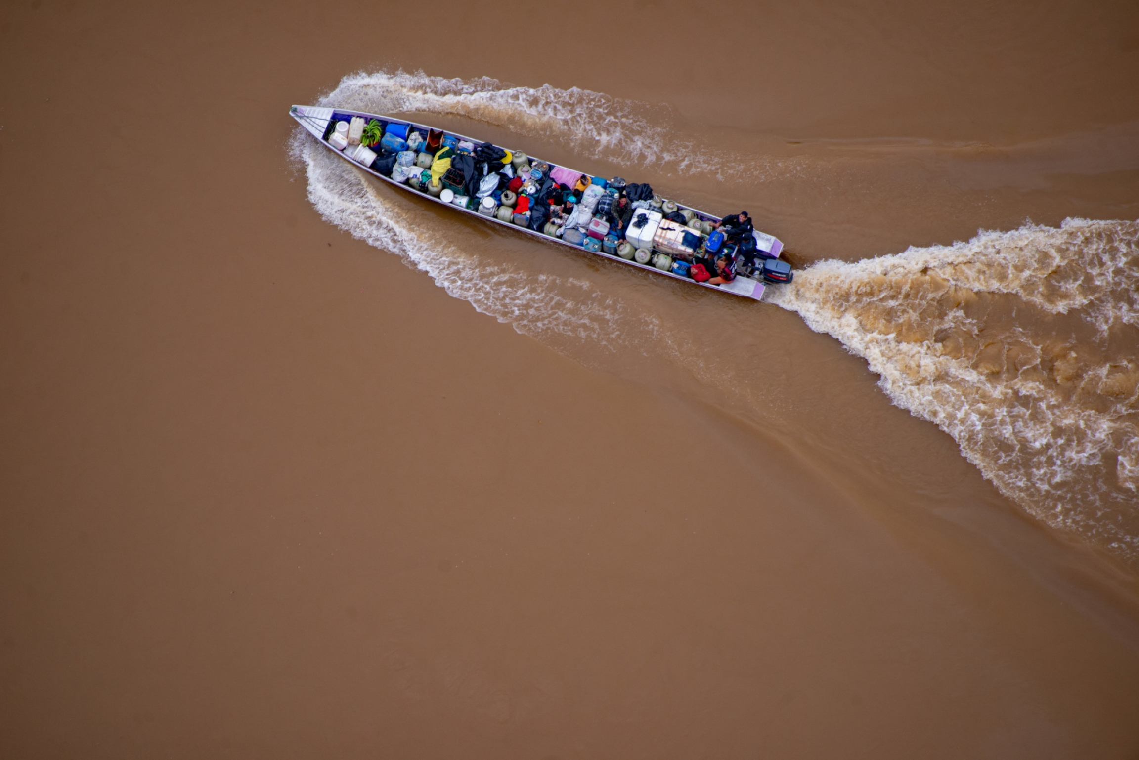 A boat transporting equipment for illegal mining operations in Yanomami Territory.