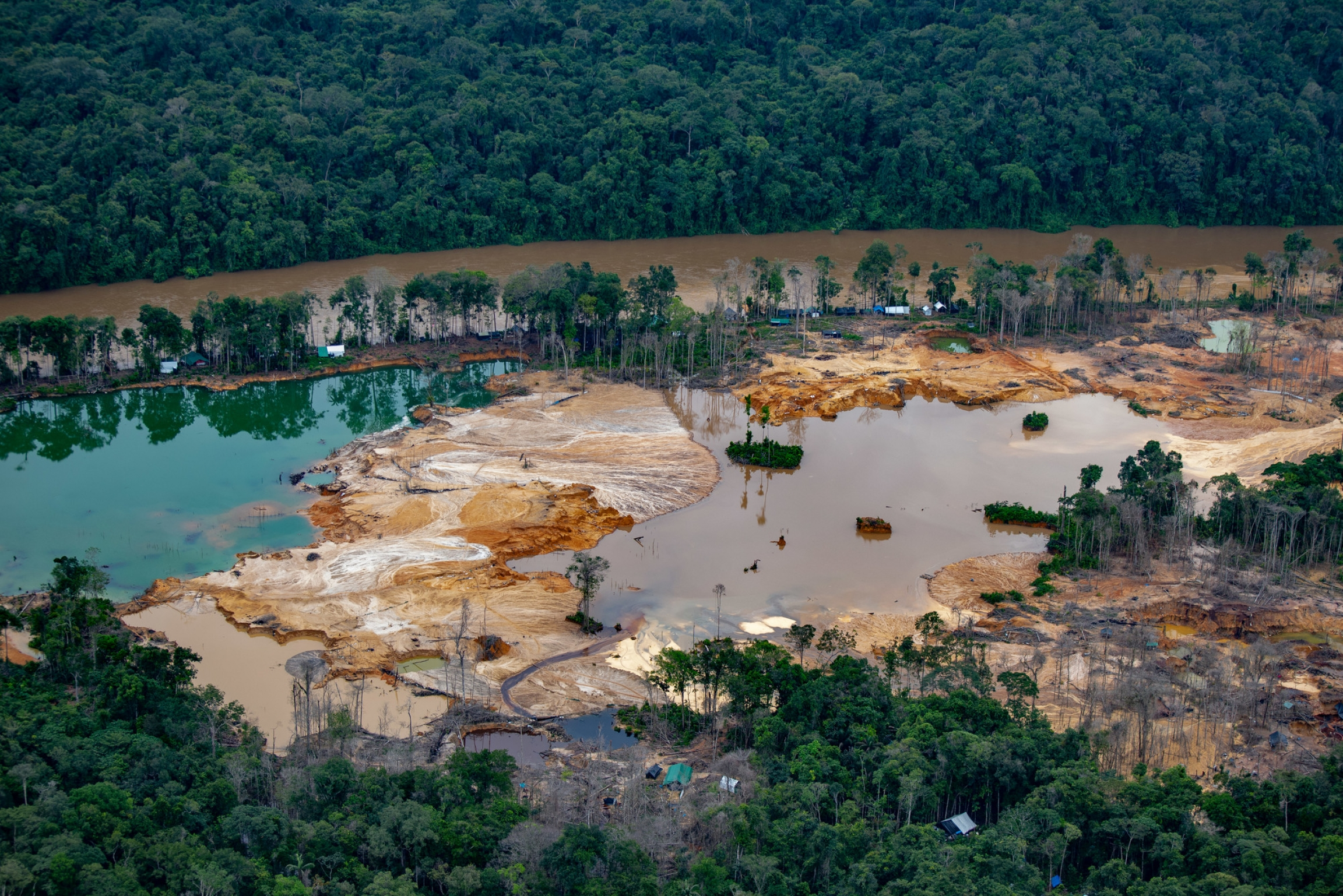 Environmental devastation caused by illegal mining operations in Yanomami land.