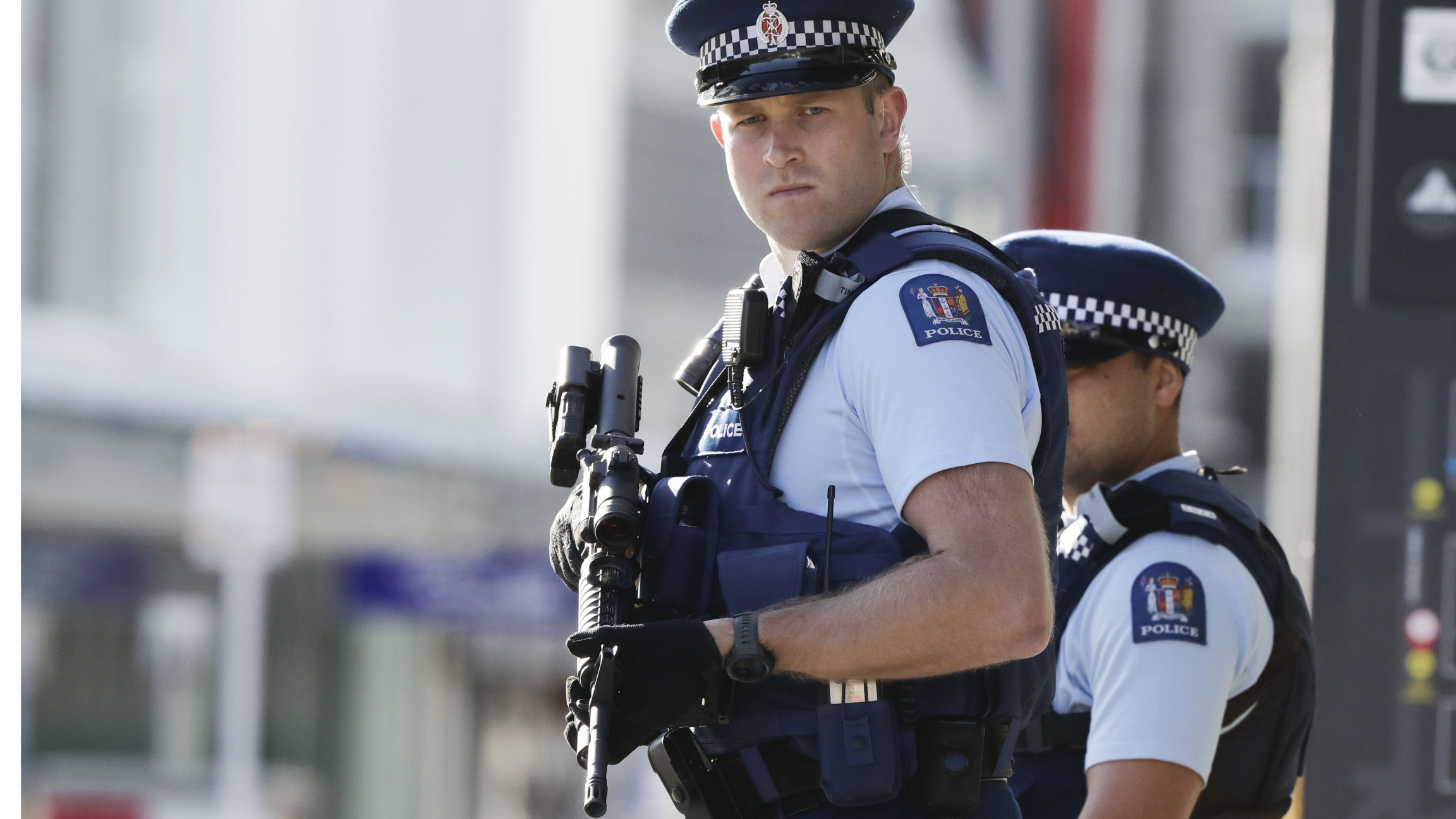 Police officers carry heavy, black guns.
