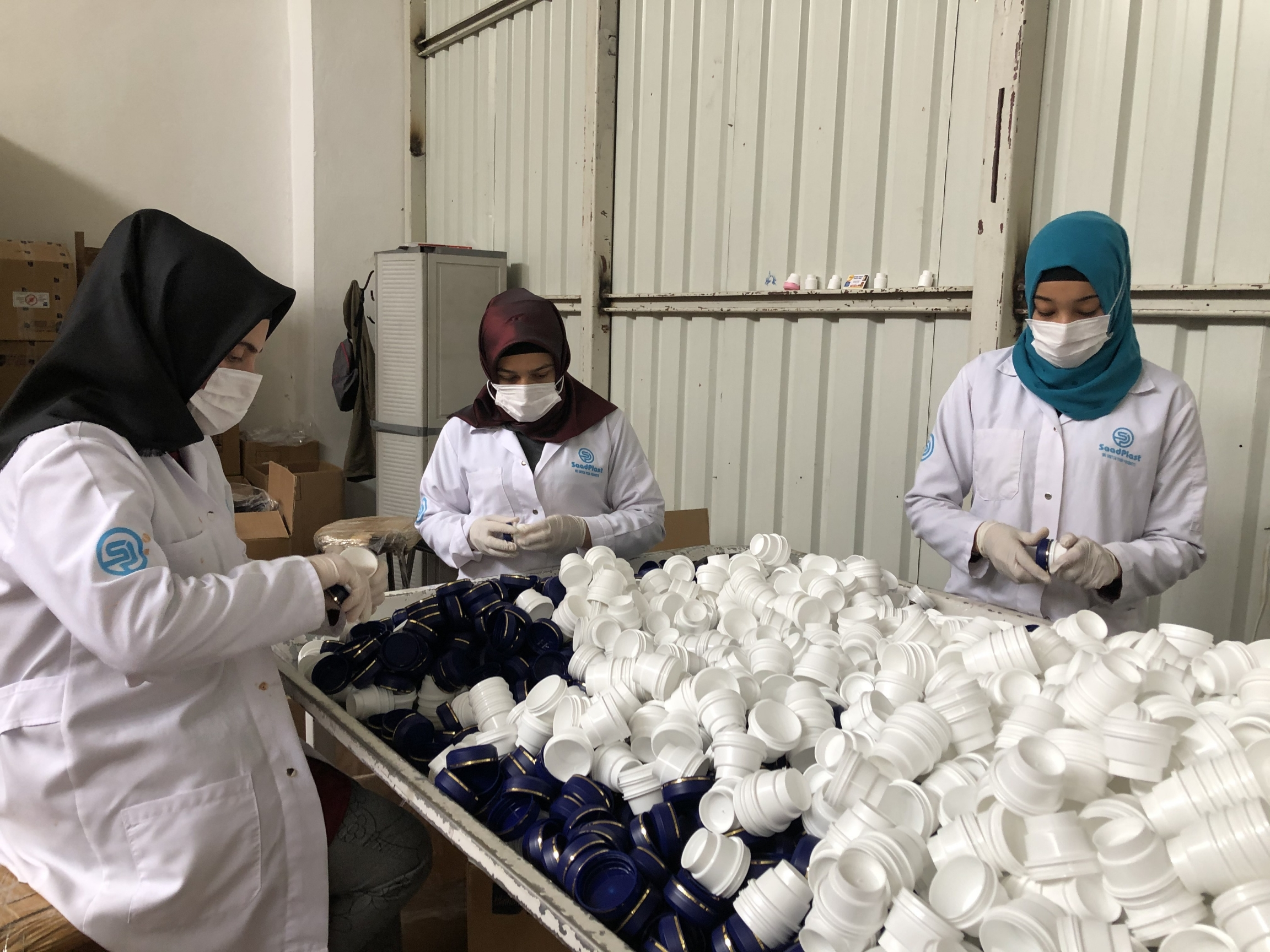 Workers at the plastic factory in Gaziantep, Turkey. Saad Chouihna started the business in Gaziantep after his family's business in Aleppo was burned down by Syrian security forces.