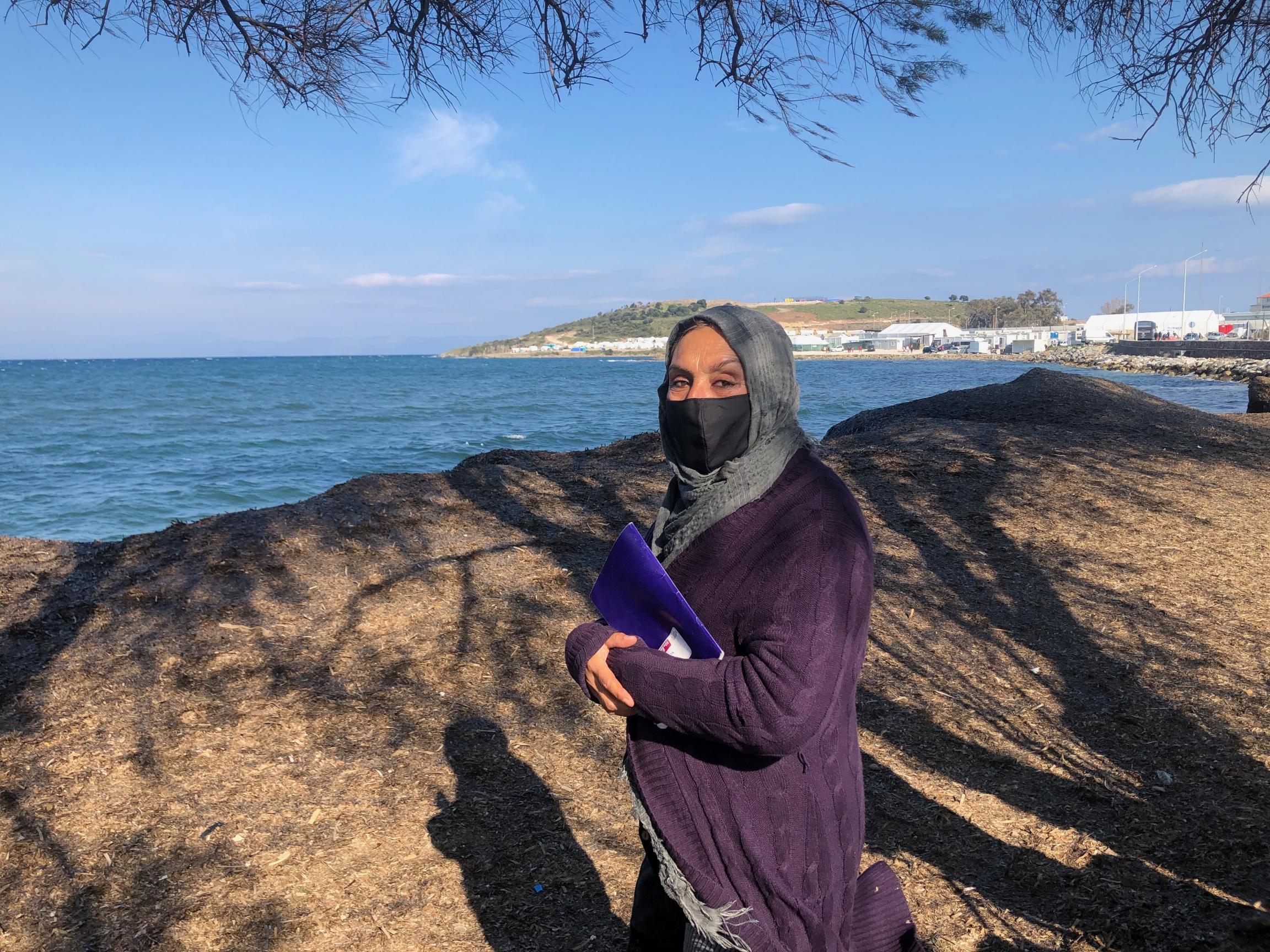 woman facing sea