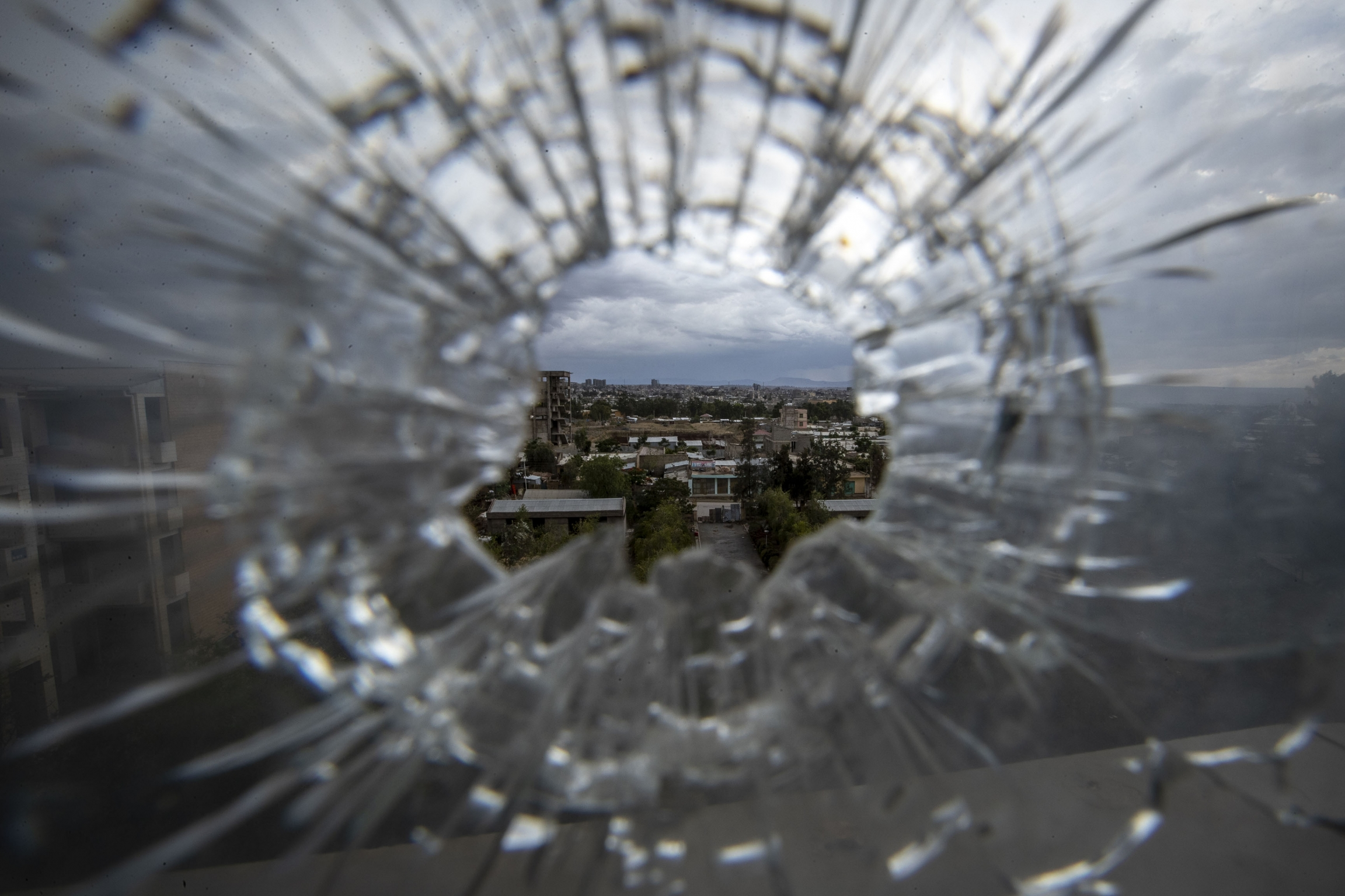 Glass shattered from bullet.