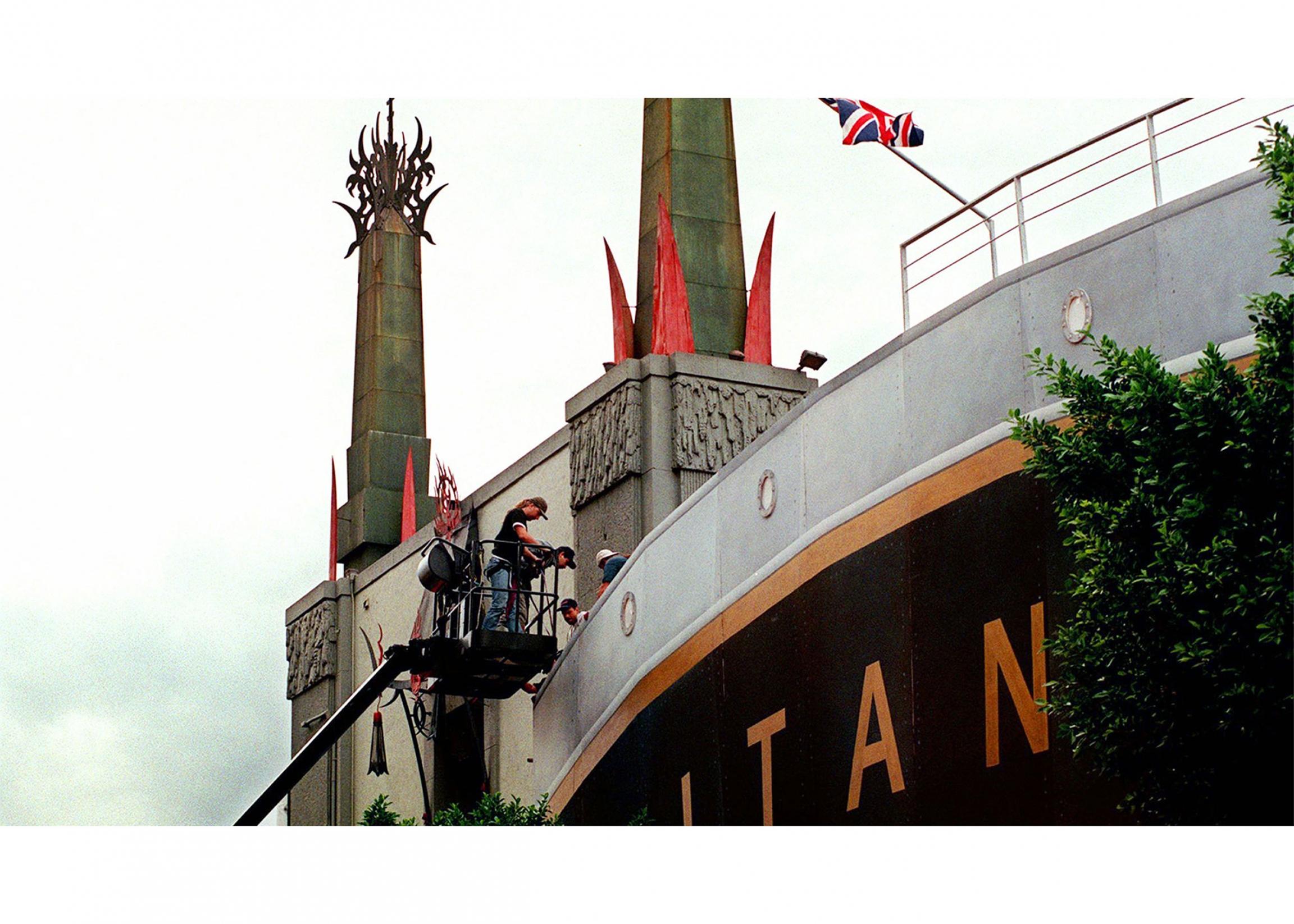 People working on a replica display of the Titanic