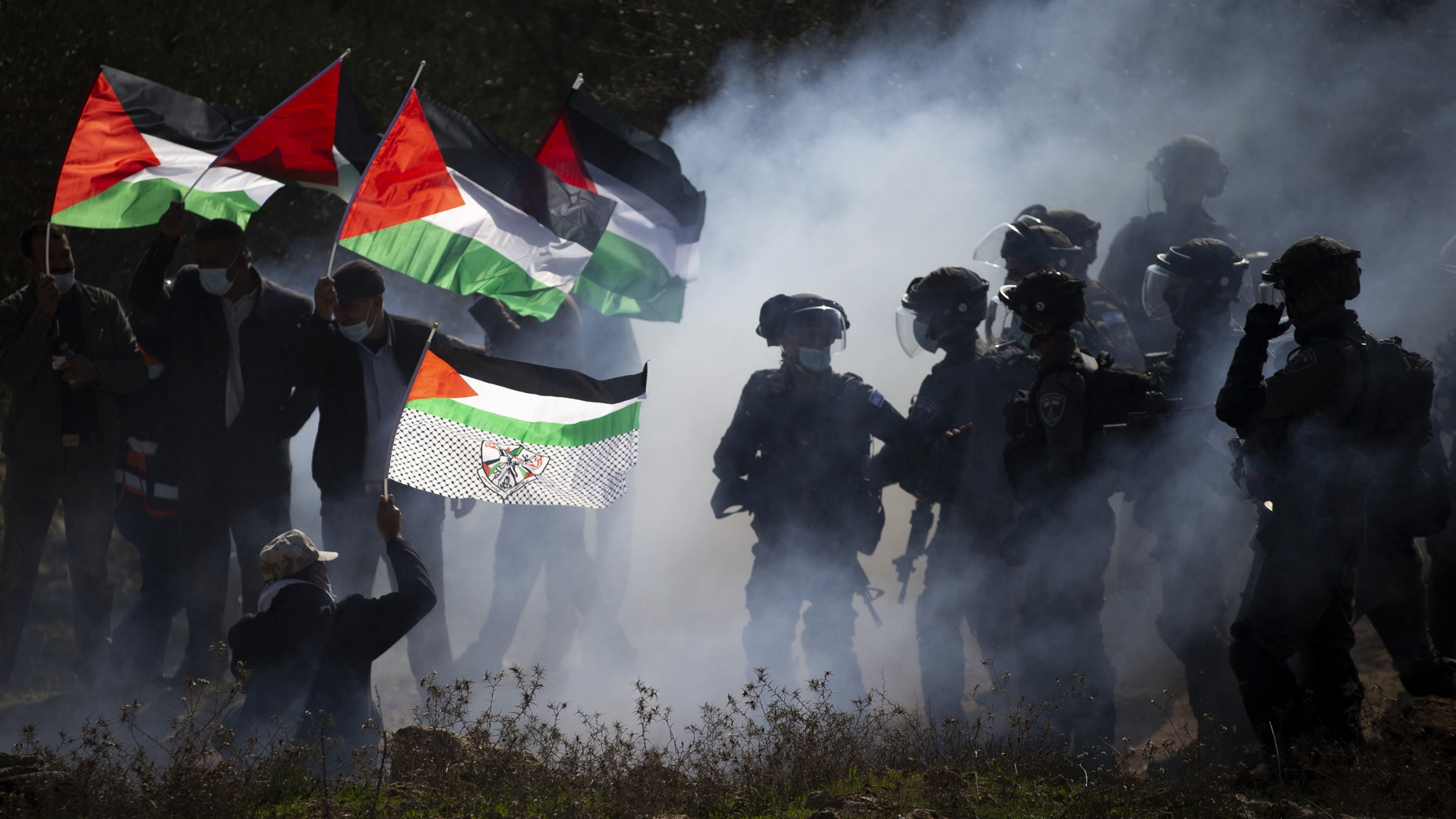 Israeli border police officers and Palestinians clash during a protest against the expansion of Israeli Jewish settlements near the West Bank town of Salfit.