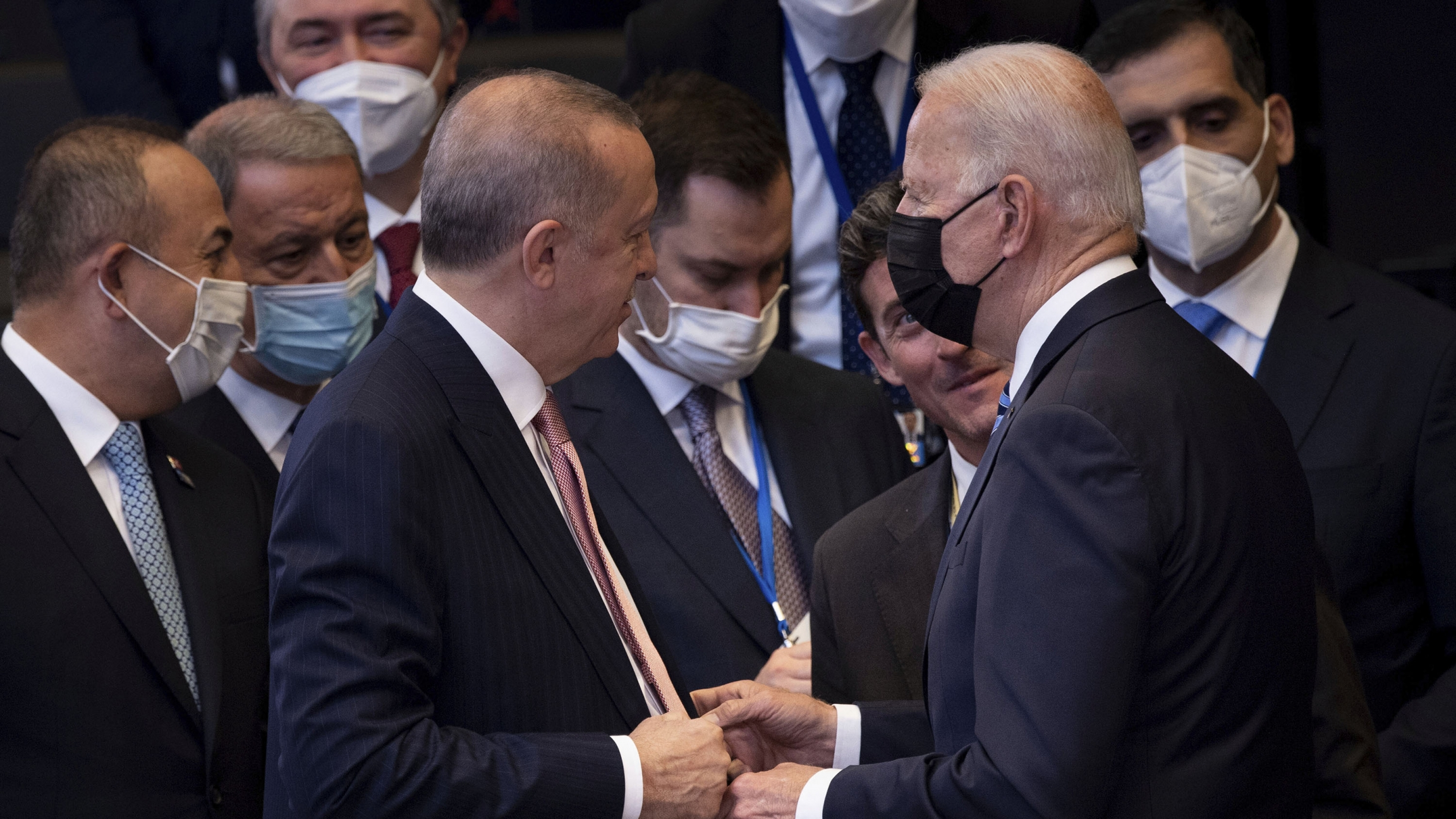 Turkey's President Recep Tayyip Erdoğan, center left, greets US President Joe Biden, center right, during a plenary session during a NATO summit at NATO headquarters in Brussels, Monday, June 14, 2021.