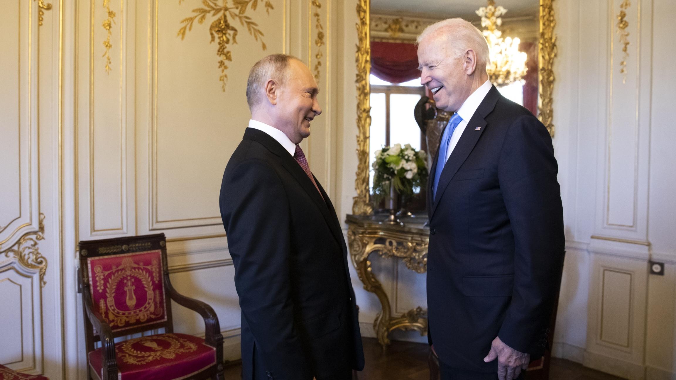 Russian president Vladimir Putin, left, talks with US President Joe Biden, right, during the US-Russia summit in Geneva, Switzerland, Wednesday, June 16, 2021.