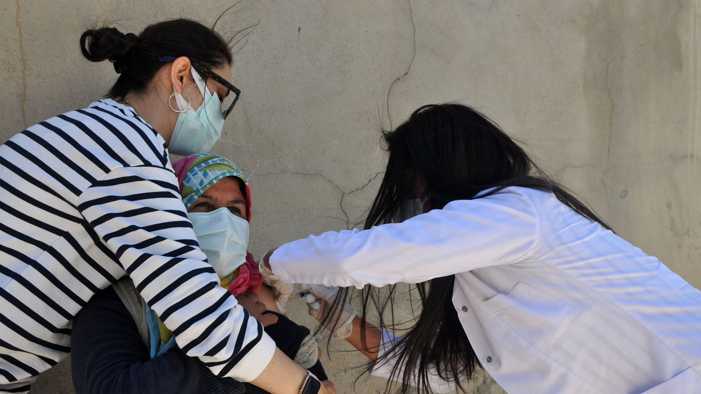 A patient receives a COVID-19 vaccine in the village of Ömerova.